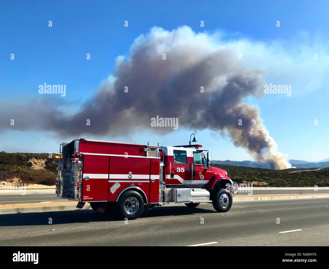 Fire truck on its way to a wildfire. - Stock Image