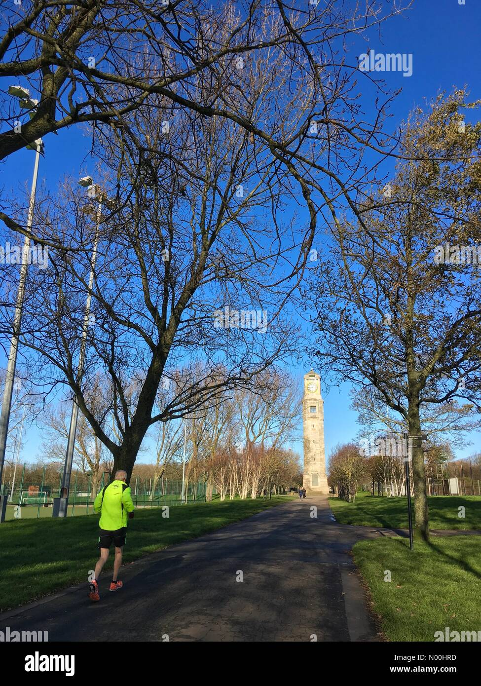 UK Weather: Sunny day in Blackpool. Clear blue skies but cold at the Clock Tower in Stanley Park, Blackpool - Stock Image