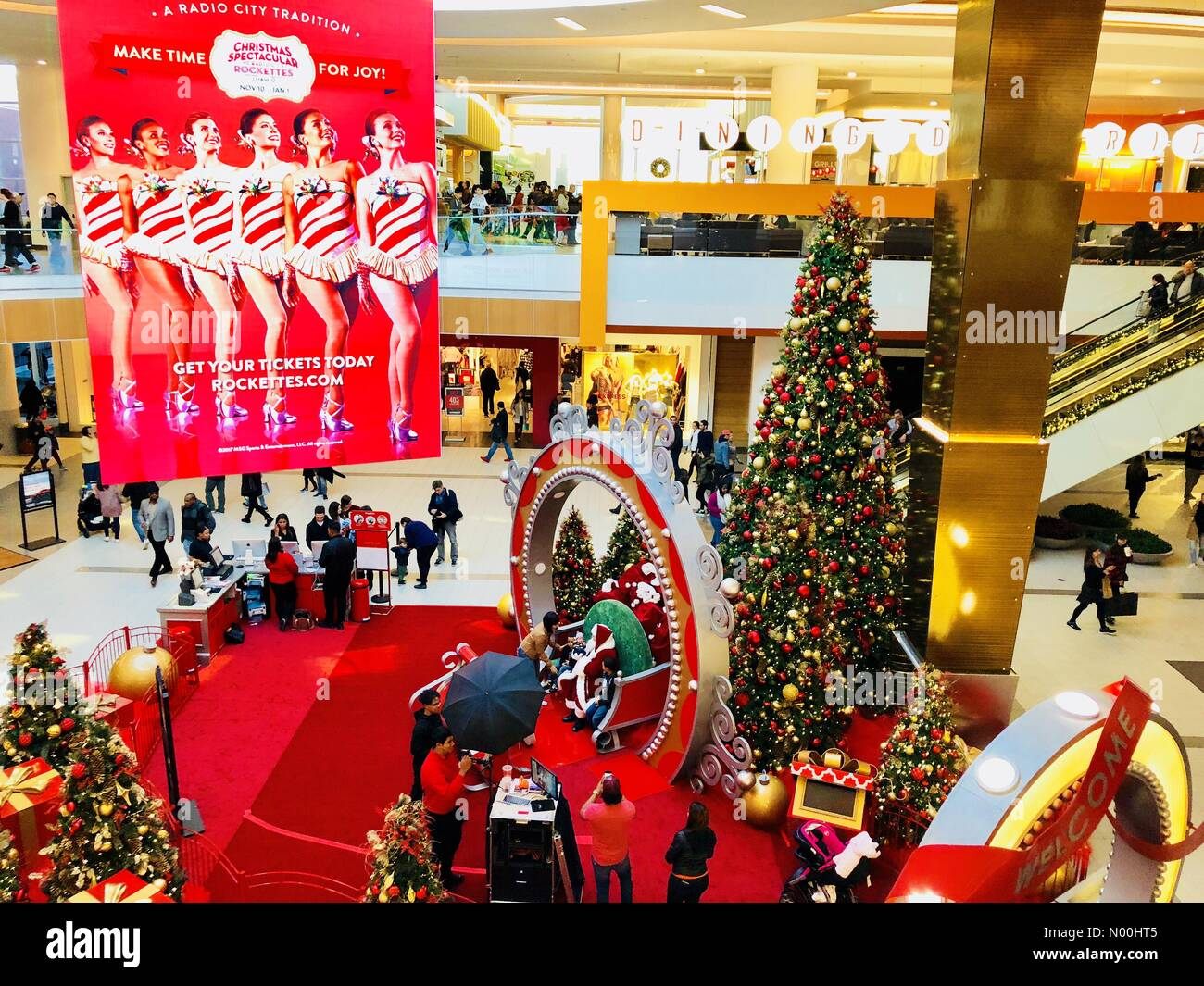 At Roosevelt Field Mall, Santa Claus has photo taken with children