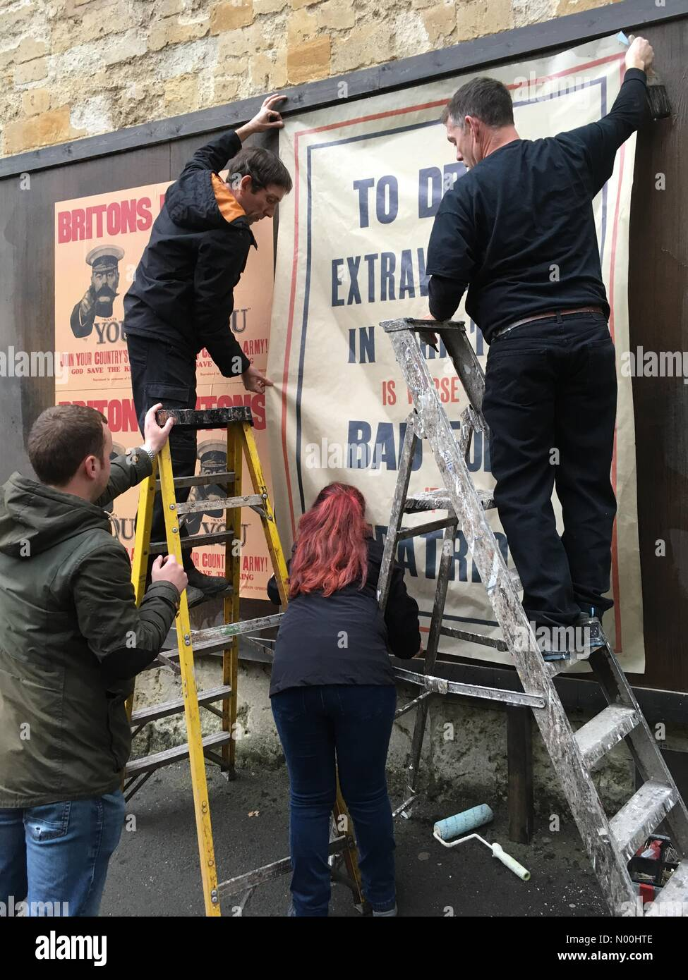 Oxford, UK. 14th Nov, 2017. Oxford, UK. 14th November 2017. Putting up First World War style posters on Brasenose - Stock Image