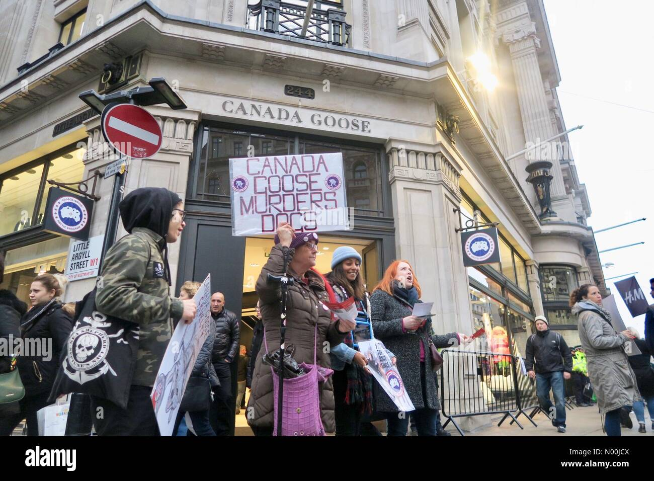 Regent Street, London, UK. 23rd Dec, 2017. Animal rights activists demonstrate outside a Canada Goose store about alleged animal rights abuse, ...