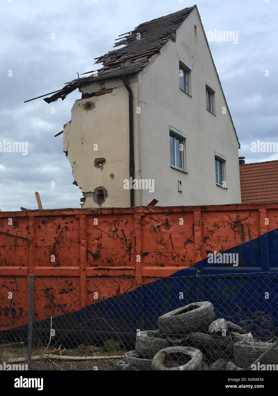 A half demolished family home in construction site, urban district Hadern, Munich, upper Bavaria, Germany, Europe - Stock Image