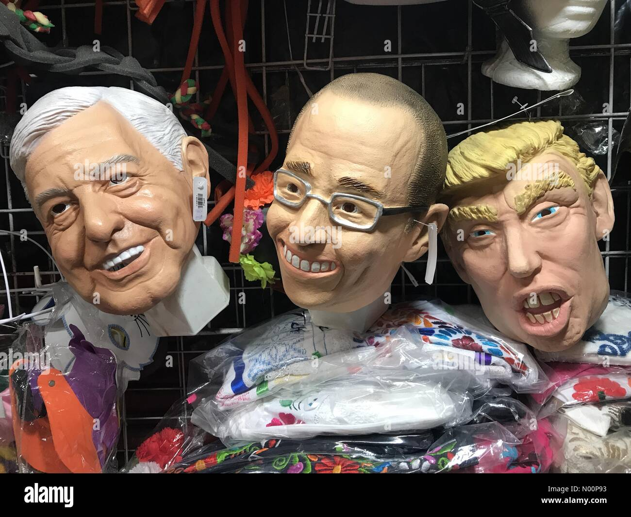 Mexico. 8th May 2018. Masks of Mexican presidential candidates Andres Manuel Lopez Obrador (AMLO) from Morena party, left, Ricardo Anaya Cortes, from PAN party and United States President Donald Trump in a market in Mexico Credit: Chico Sanchez/StockimoNews/Alamy Live News Stock Photo
