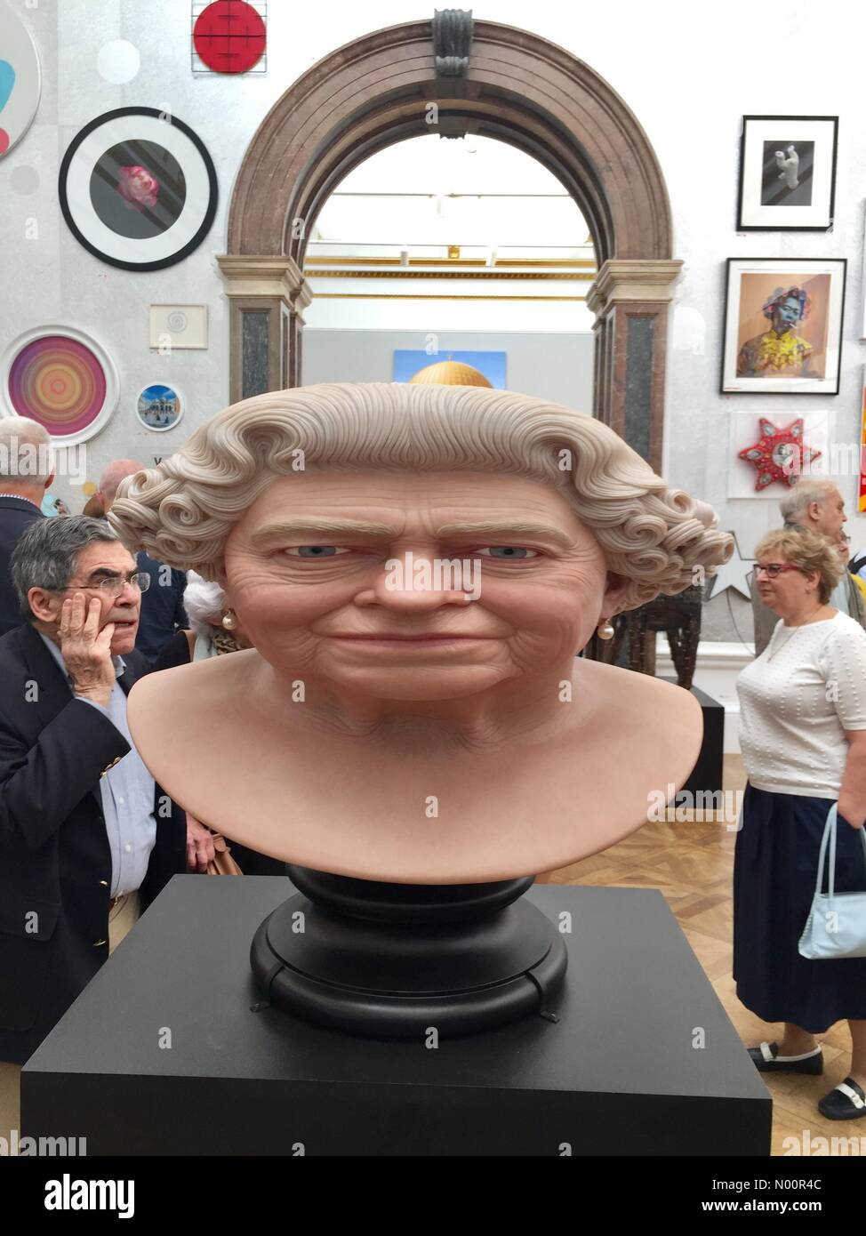 Royal Academy of Arts Summer Open Exhibition Private View Launch with stretched queens head sculpture by John Humphries. Stock Photo