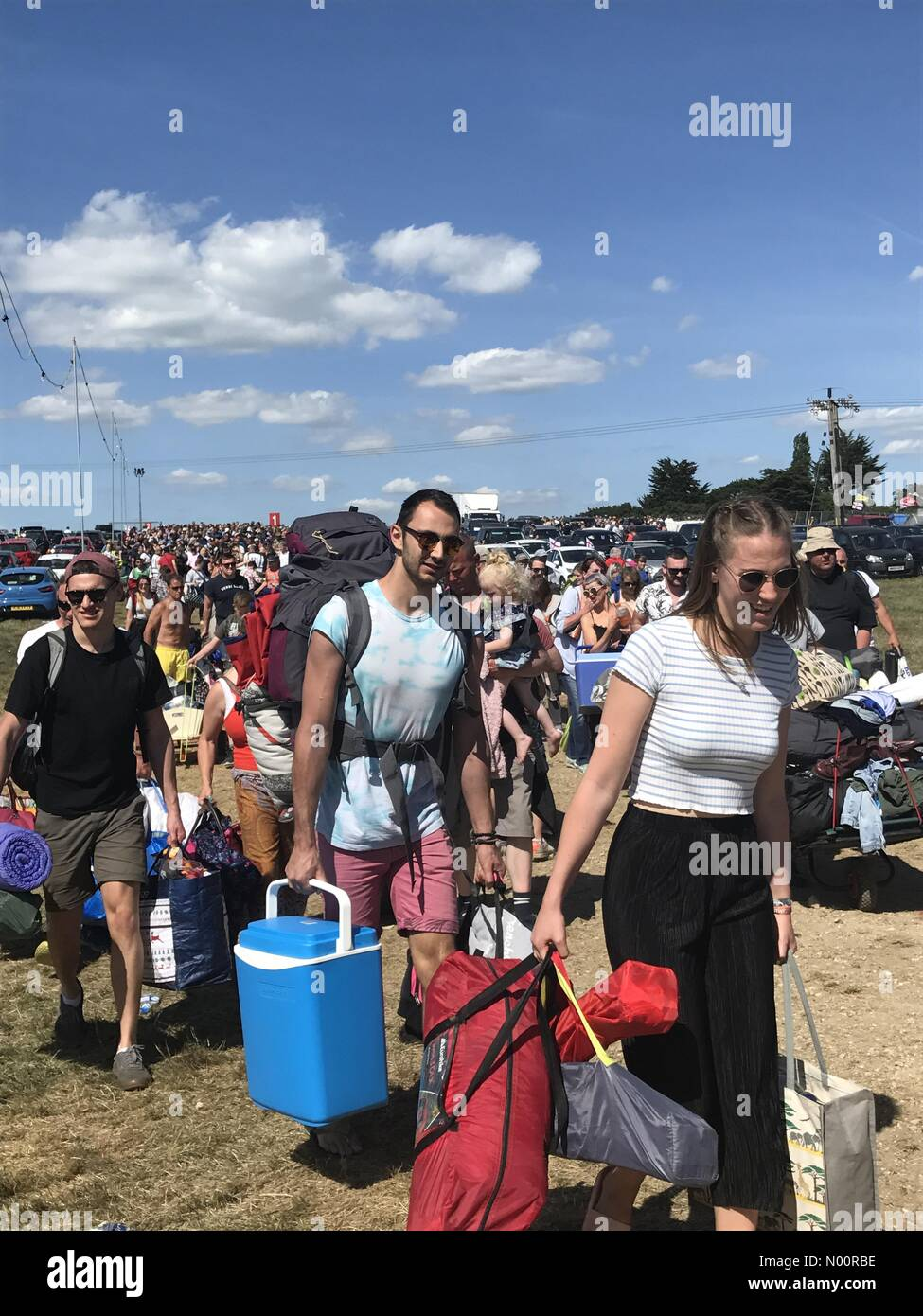 East Cowes, Newport, UK. 21st June, 2018. Seaport Close, Newport, Isle of Wight. 21st Jun, 2018. Hundreds of festival-goers enter the Isle of Wight festival site after a long wait in the heat. Credit: amylaura/StockimoNews Credit: amylaura/StockimoNews/Alamy Live News - Stock Image