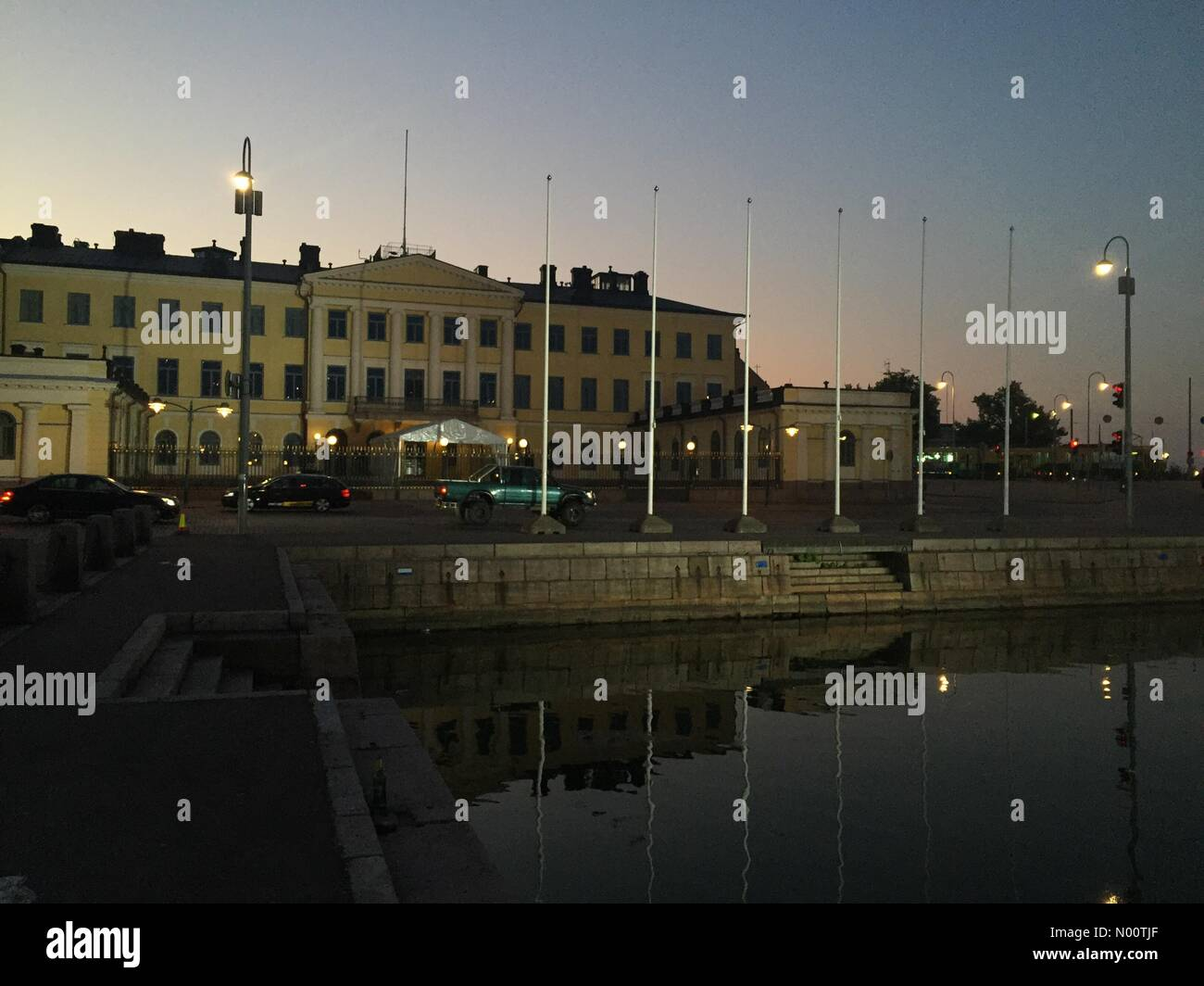 Presidential Palace, Helsinki, Finland. 16th July 2018. Buzy news day turns into warm summer night at location of Trump-Putin Summit, Finland's Presidential Palace of Sauli Niinistö. - Stock Image