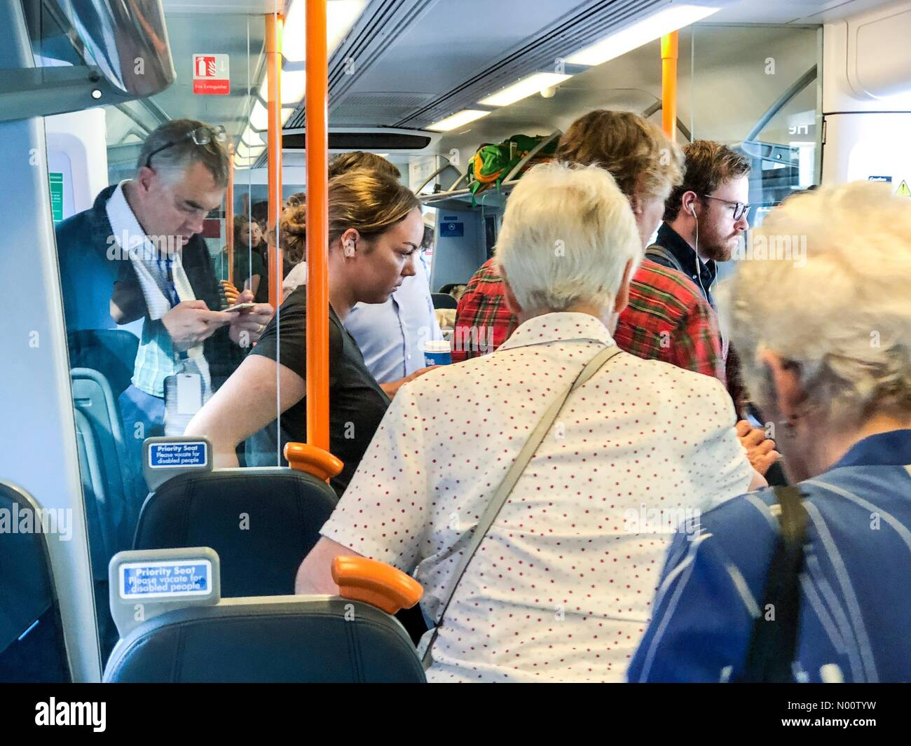 Guildford GU4UP, UK. 26th July, 2018. SW Trains, Milford, UK. Strike action by railway guards caused massive disruption today on the Portsmouth-Waterloo line. Commuters on South West trains running late. Credit: jamesjagger/StockimoNews/Alamy Live News - Stock Image