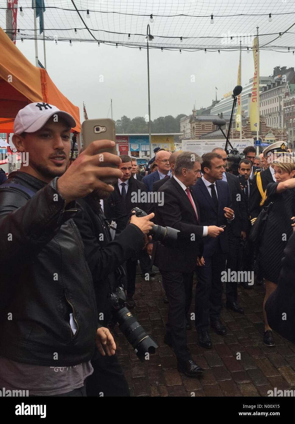 Helsinki, Finland. 30th Aug, 2018. Kauppatori, Helsinki, Finland. 30th August 2018. French President Emmanuel Macron and Finnish President Sauli Niinistö had a walk at market place after discussing military partnership issues. Credit: Heini Kettunen/StockimoNews/Alamy Live News - Stock Image