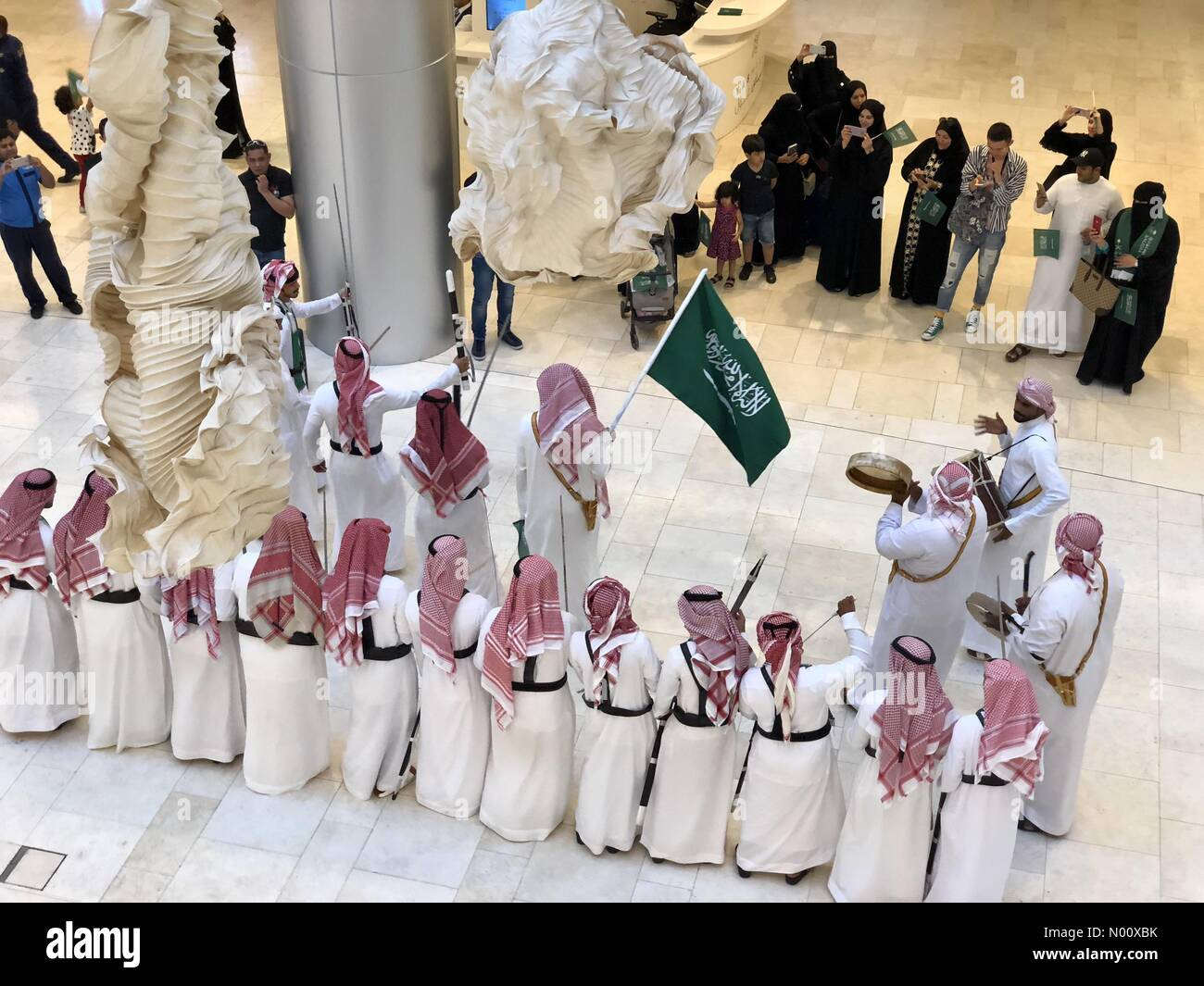 Yas Mall Abu Dhabi, UAE. 23 September, 2018: Saudi national day celebrations held as Traditional Dancers performers in sync - Yas Mall Abu Dhabi, UAE Credit: Mava Fahd/StockimoNews/Alamy Live News - Stock Image