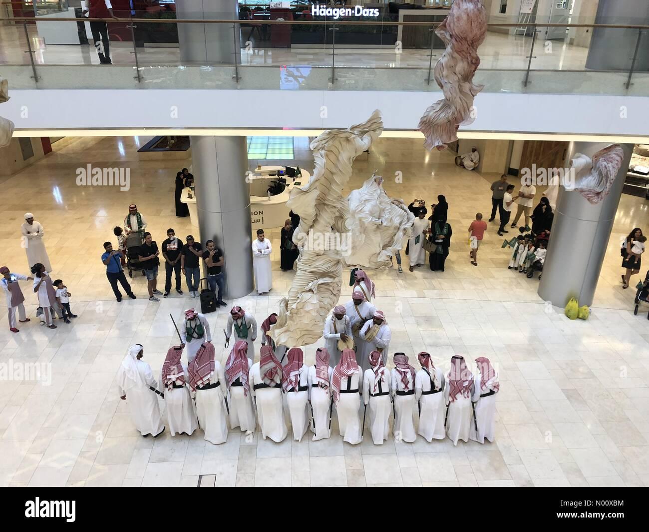 Yas Mall Abu Dhabi, UAE. 23 September, 2018: Saudi national day celebrations held as Traditional Dancers performers in sync - Yas Mall Abu Dhabi, UAE. Credit: Mava Fahd/StockimoNews/Alamy Live News - Stock Image