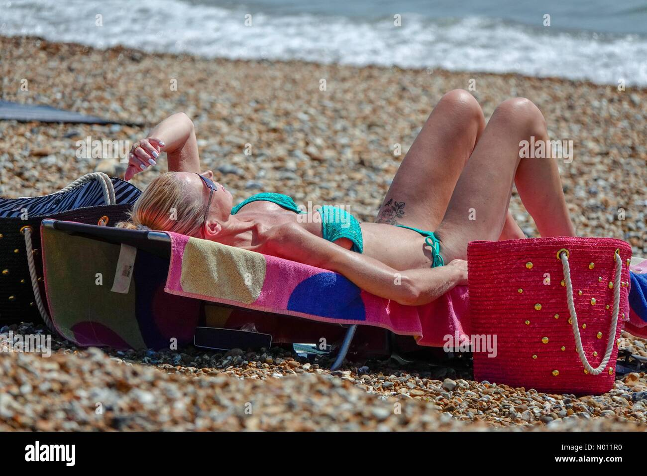UK Weather: Hot and sunny at Hayling. Beachlands, Hayling Island. 23rd July 2019. Beautiful weather along the south coast today. People enjoying the beach at Hayling Island in Hampshire. Credit: jamesjagger/StockimoNews/Alamy Live News Stock Photo