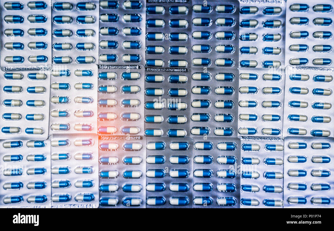 Blue and white capsules pill in blister pack arranged with beautiful pattern. Global healthcare concept. Antibiotics drug resistance. Antimicrobial ca - Stock Image
