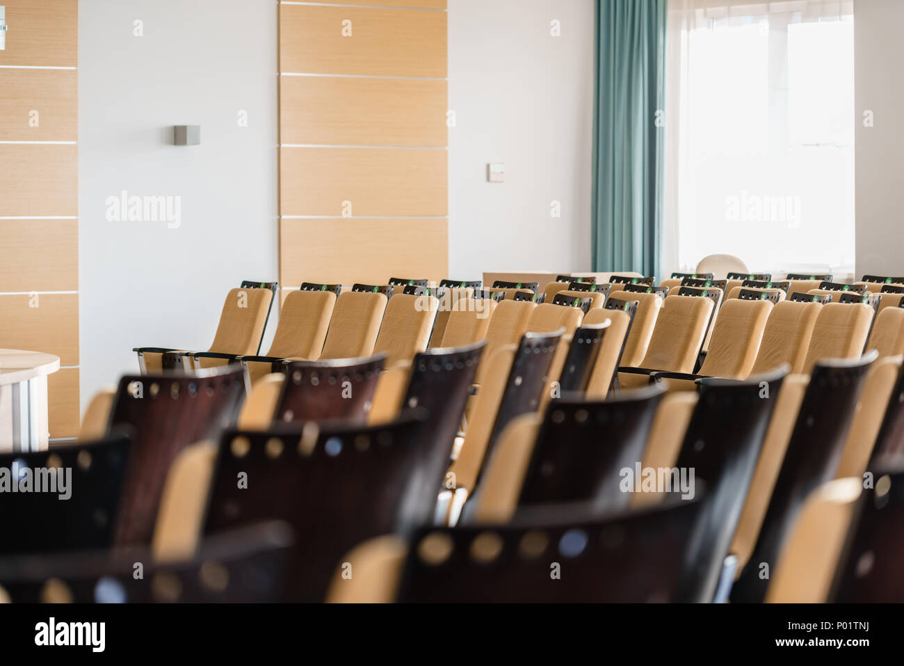 Seminar presentation. Empty conference room, lots of empty seats. Auditorium for workshops and seminars - Stock Image