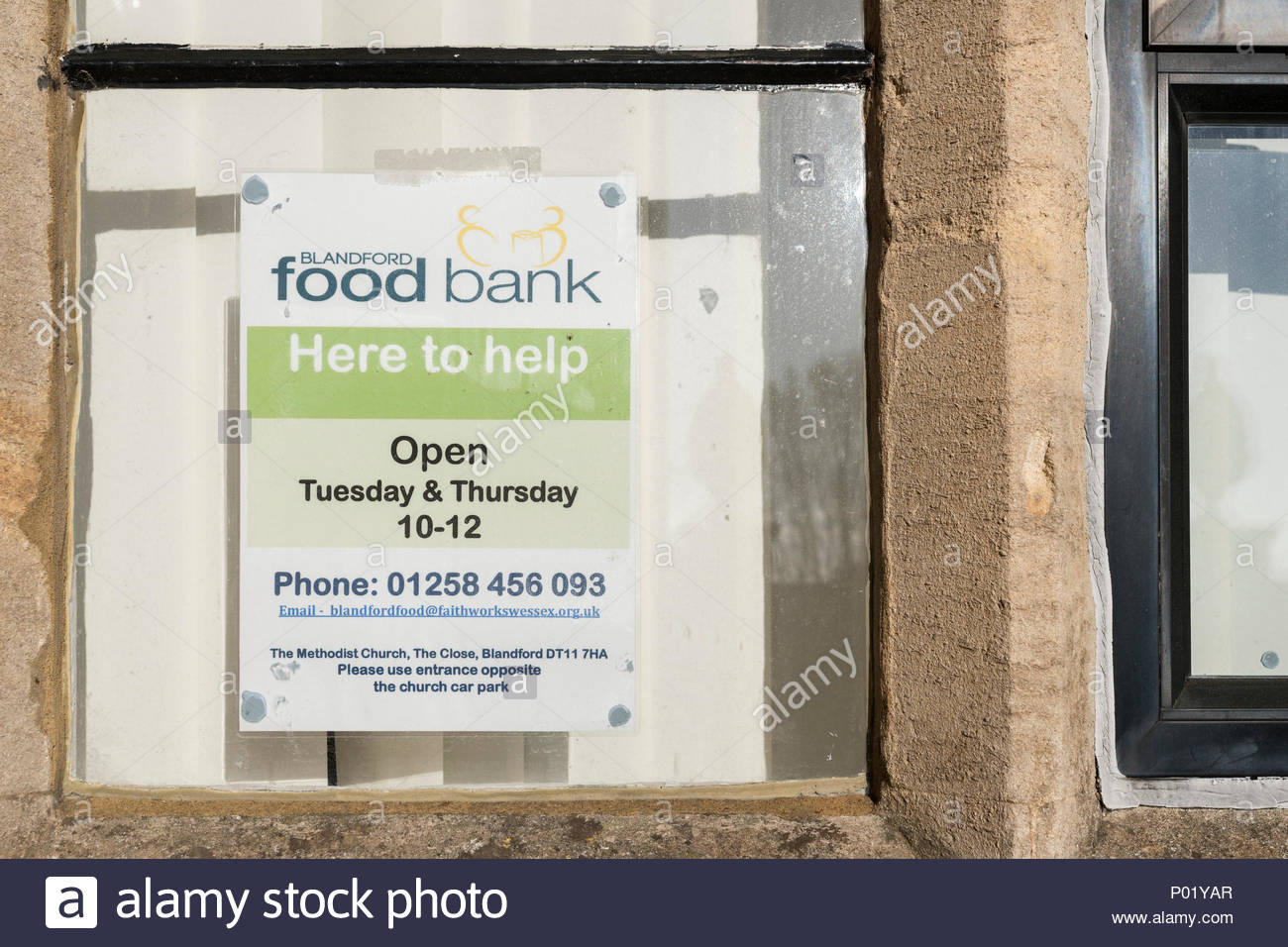 Food bank poster, Blandford, Dorset, England, UK - Stock Image