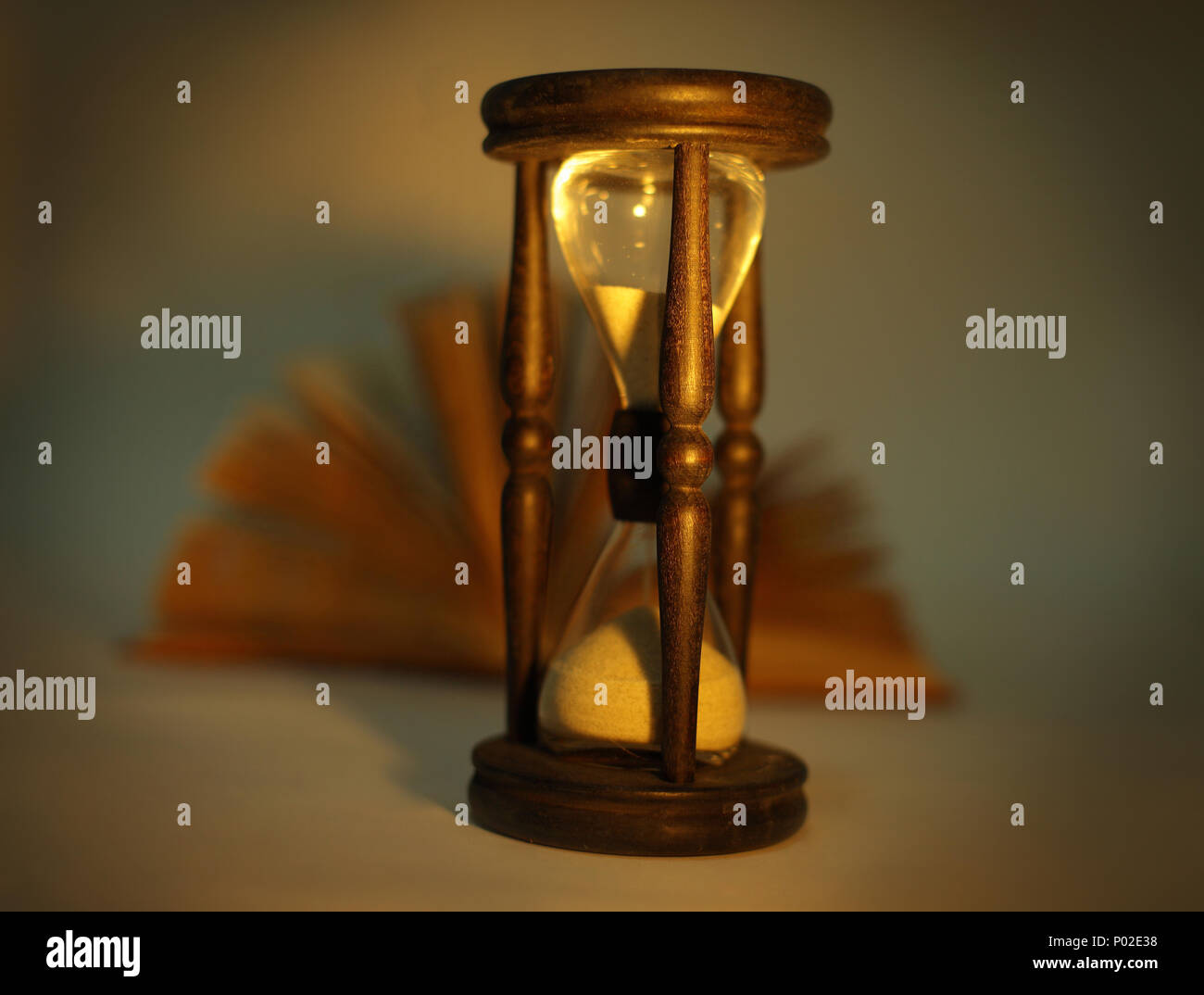 Sand glass clock with book - Stock Image