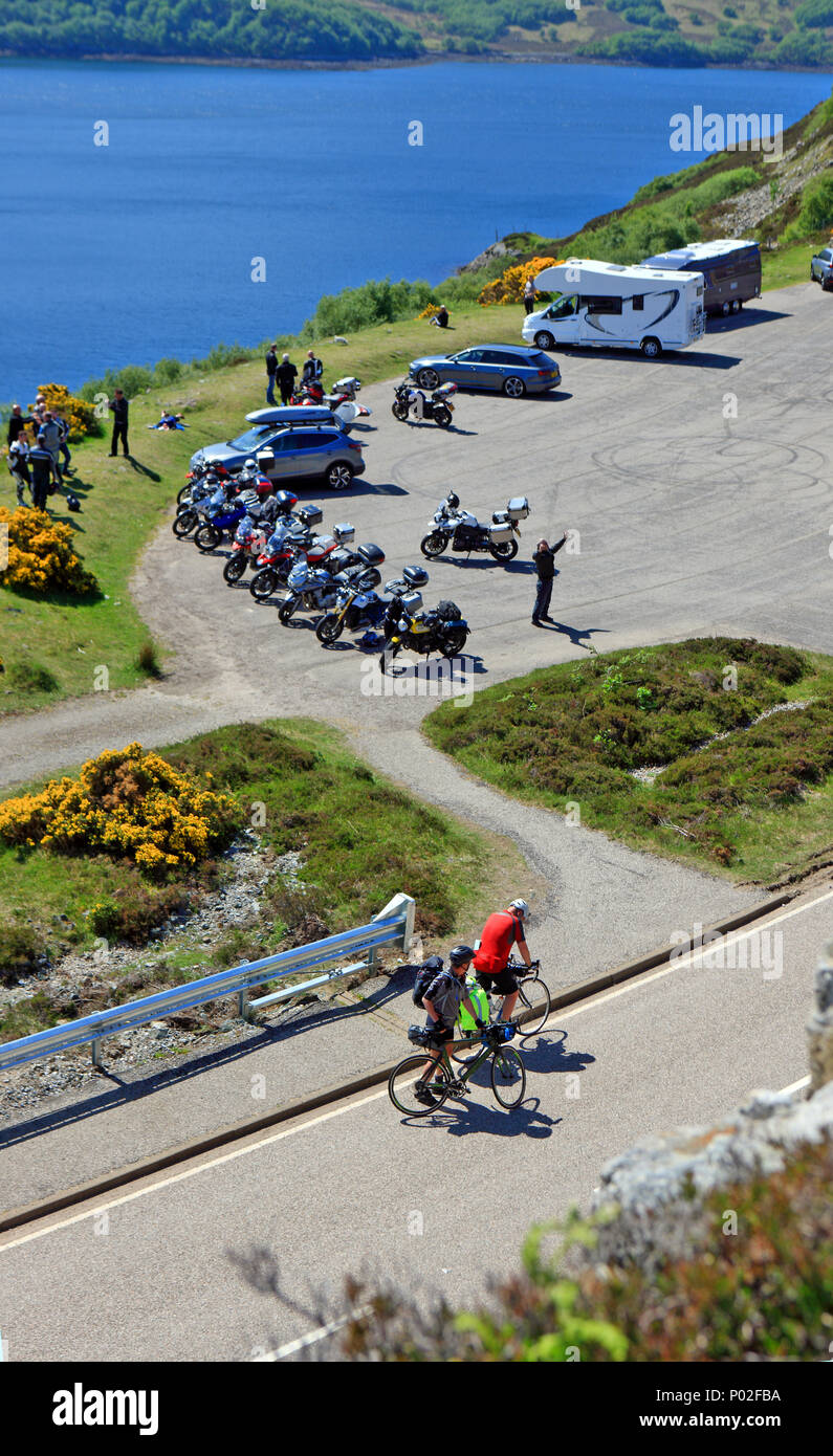 Kylesku Bridge carpark and visitor viewpoint filled with bikers and campervans and part of the North Coast 500 route. - Stock Image