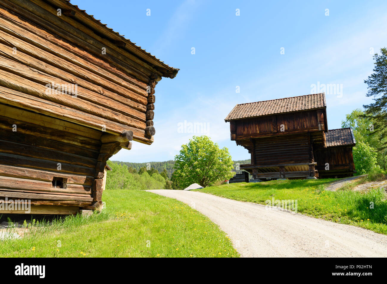 Charmant Old Wooden Storage Buildings On Either Side Of A Road On The Norwegian  Countryside On A Sunny Day. Location Heddal, Norway.