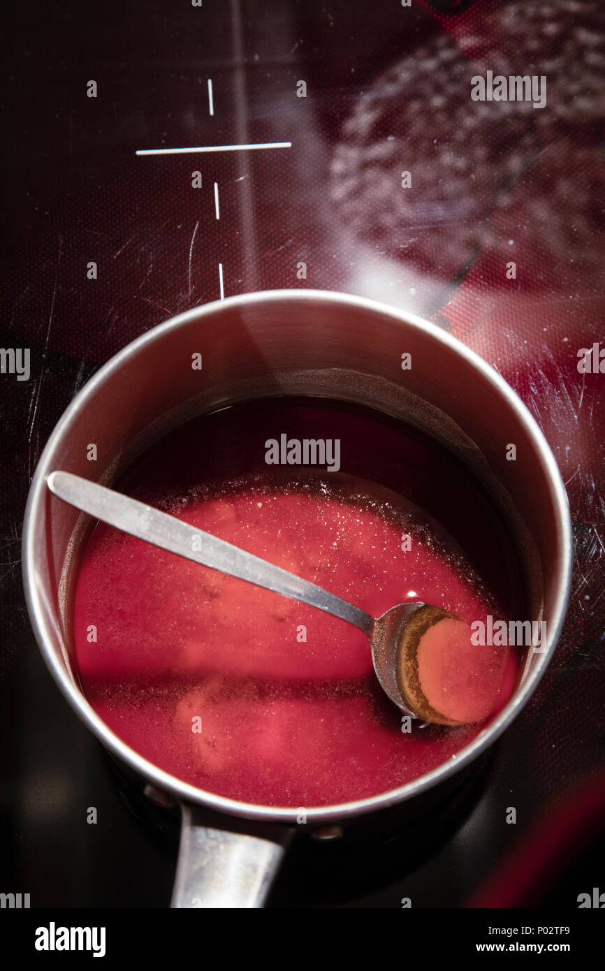 Evening of gastronomy, cooking pan with red background, Melbourne, Australia - Stock Image