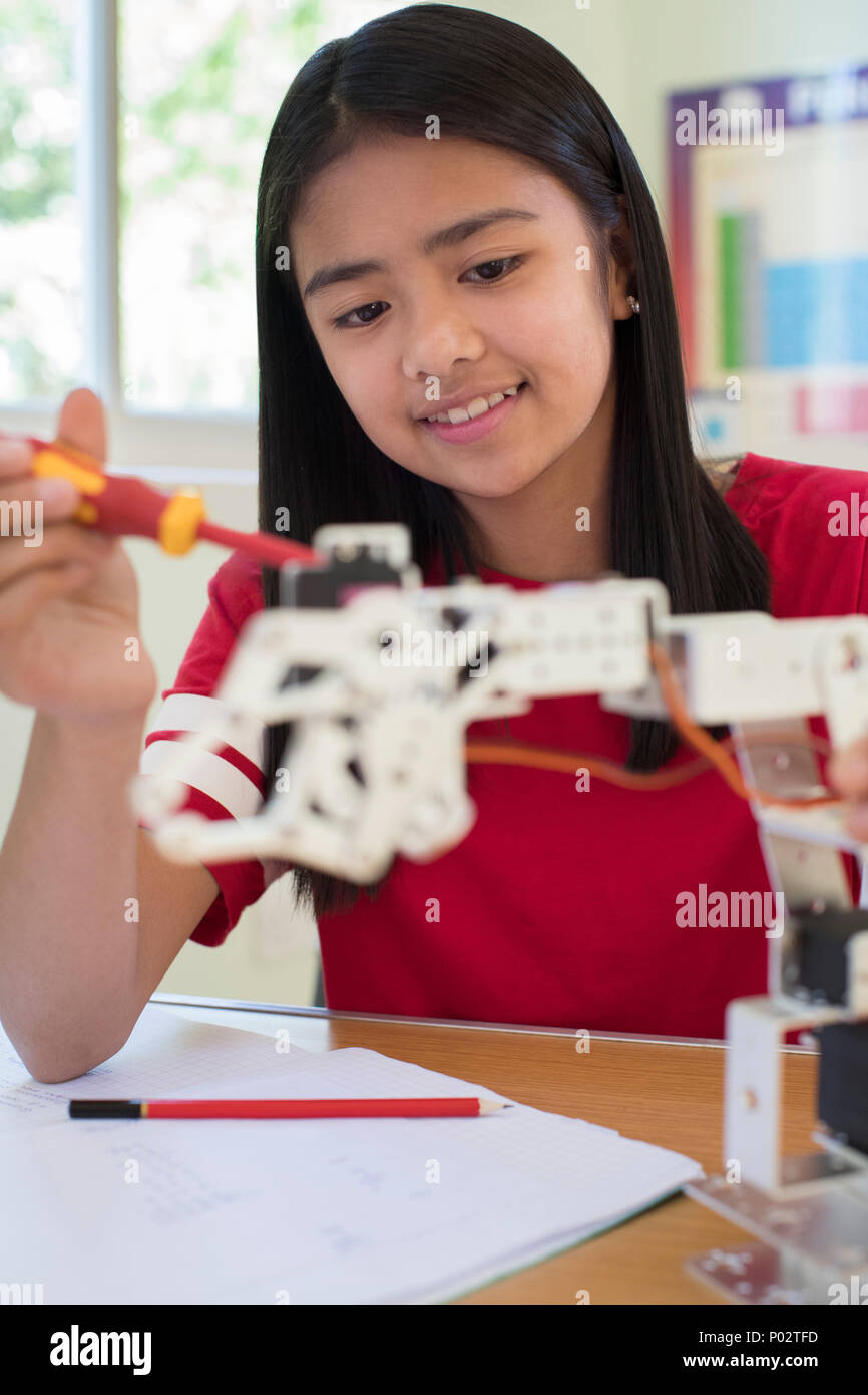 Female Pupil In Science Lesson Studying Robotics Stock Photo
