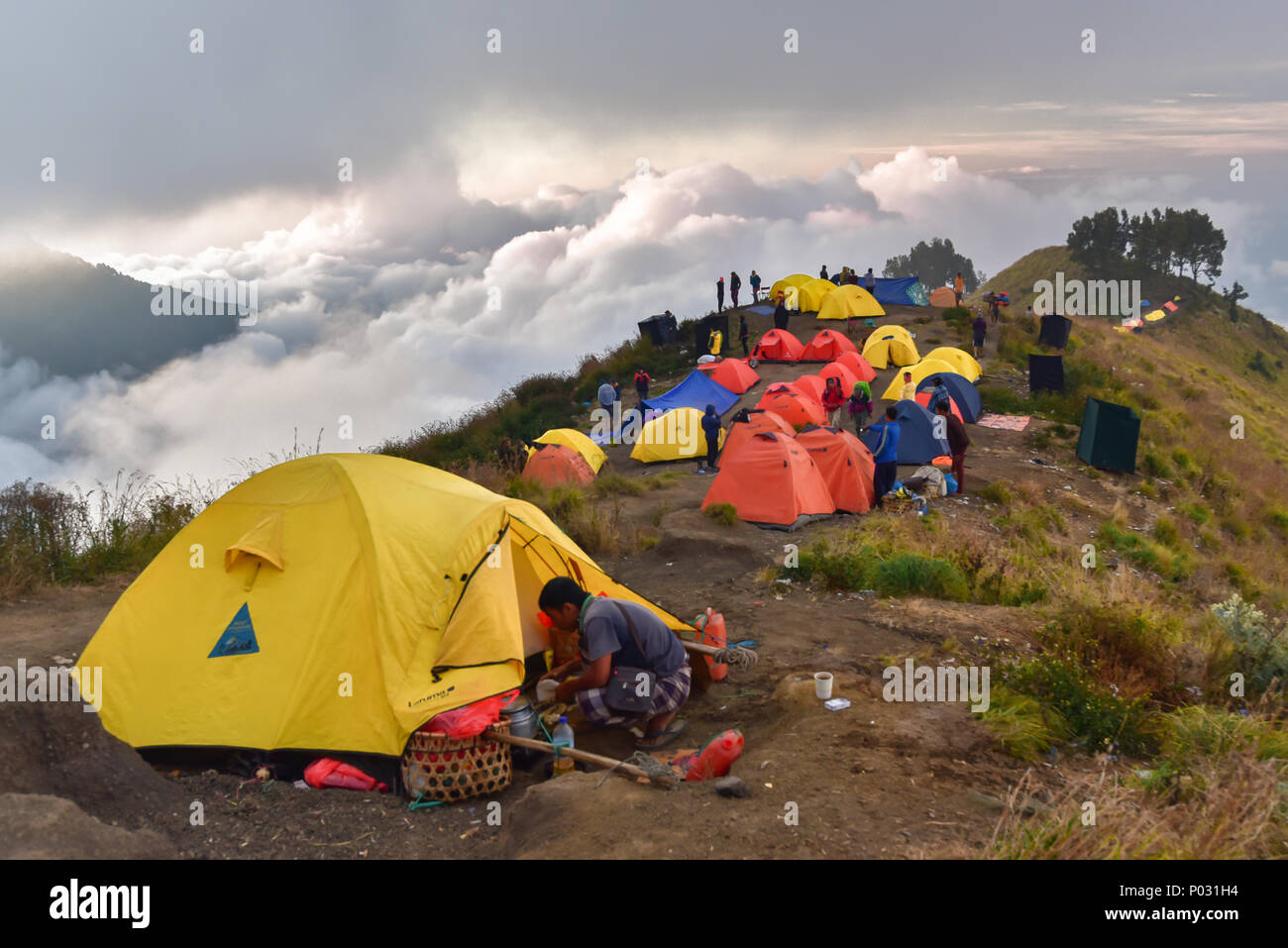 Tents of the hikers at Crater Lake of Rinjani Volcano, Lombok - Stock Image