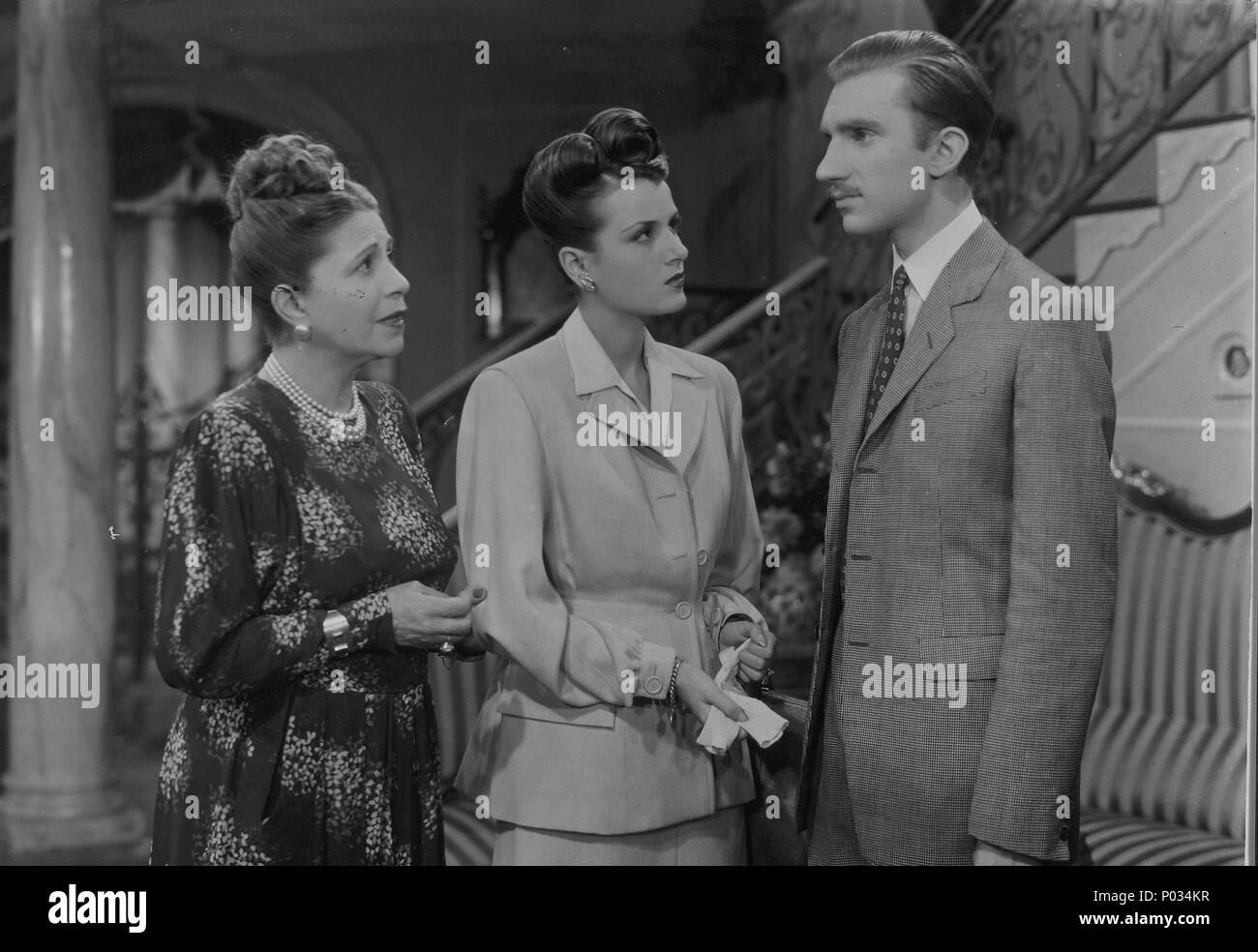 Original Film Title: ES PELIGROSO ASOMARSE AL EXTERIOR.  English Title: ES PELIGROSO ASOMARSE AL EXTERIOR.  Film Director: ALEJANDRO ULLOA.  Year: 1946.  Stars: FERNANDO FERNAN GOMEZ; ANA MARIA CAMPOY; GUADALUPE SAMPEDRO. Stock Photo