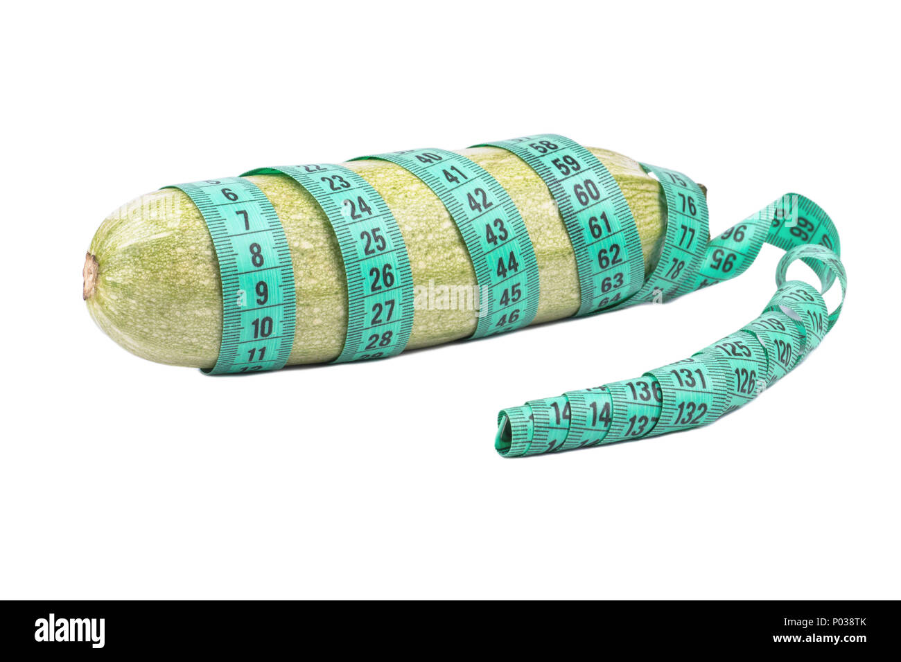 Green vegetable marrow wrapped meter on a white background - Stock Image