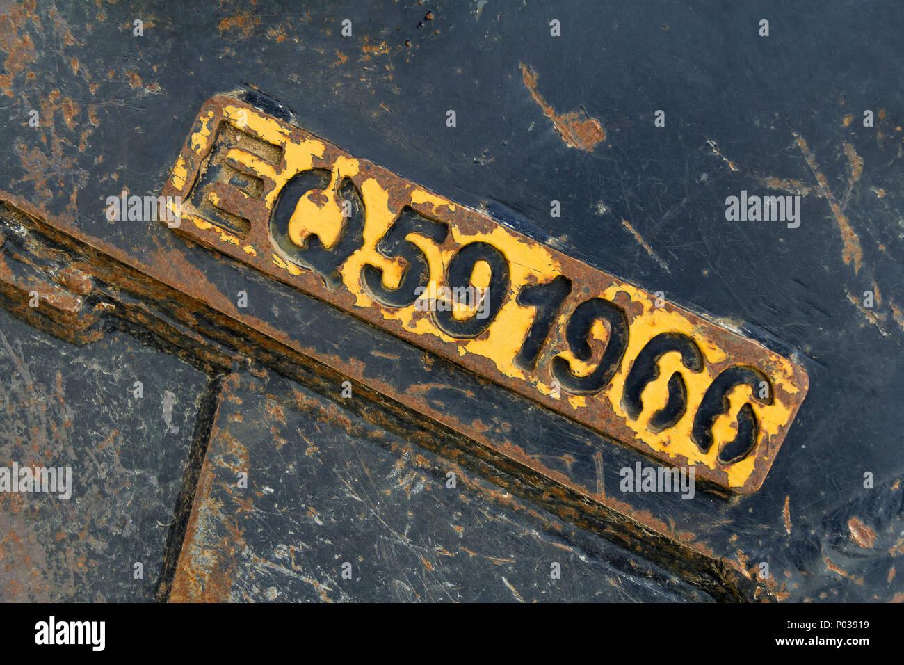 embossed number in rundown peeling metallic ambiance Stock Photo