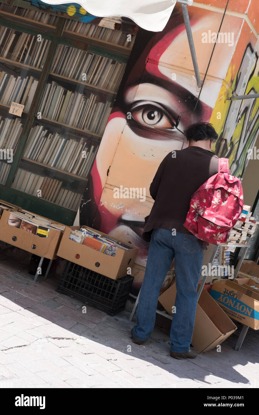 Man reading at street second hand book stall, Athens, Greece. - Stock Image