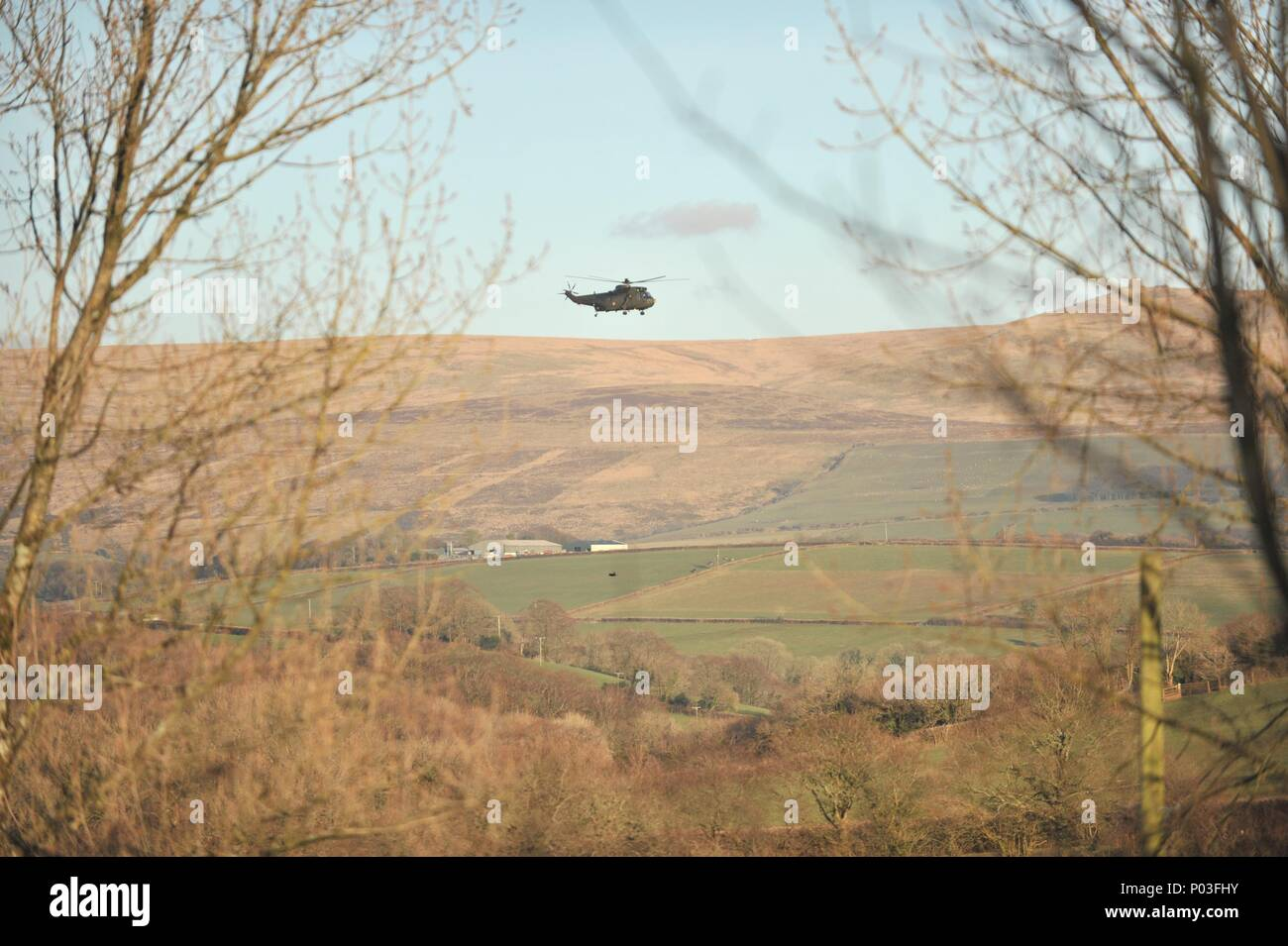 Sea King army helicopter over Dartmoor - Stock Image