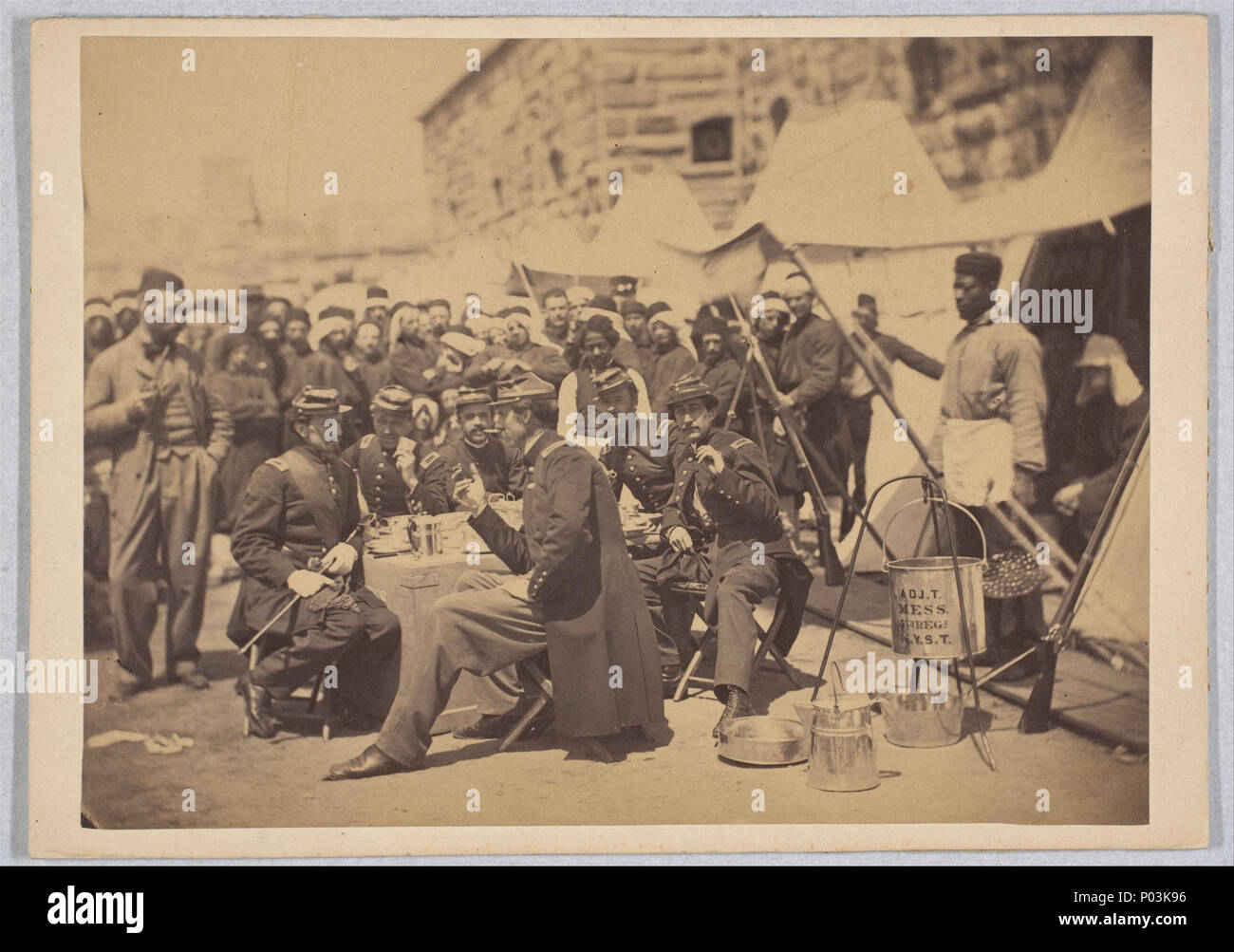 . English: Duryea Zouaves, Adjutant General Regimental Mess, Fort Schuyler, May 18, 1861. Metropolitan Museum of Art: Albumen silver print from glass negative, 5 9/16 x 7 1/2 Accession Number: 2005.100.1231 Provenance: Alfred R. Waud Collection, Civil War Illustrator   http://www.metmuseum.org/art/collection/search/285894 8 Duryea Zouaves, Regimental Mess, Fort Schuyler, May 18, 1861 - Stock Image