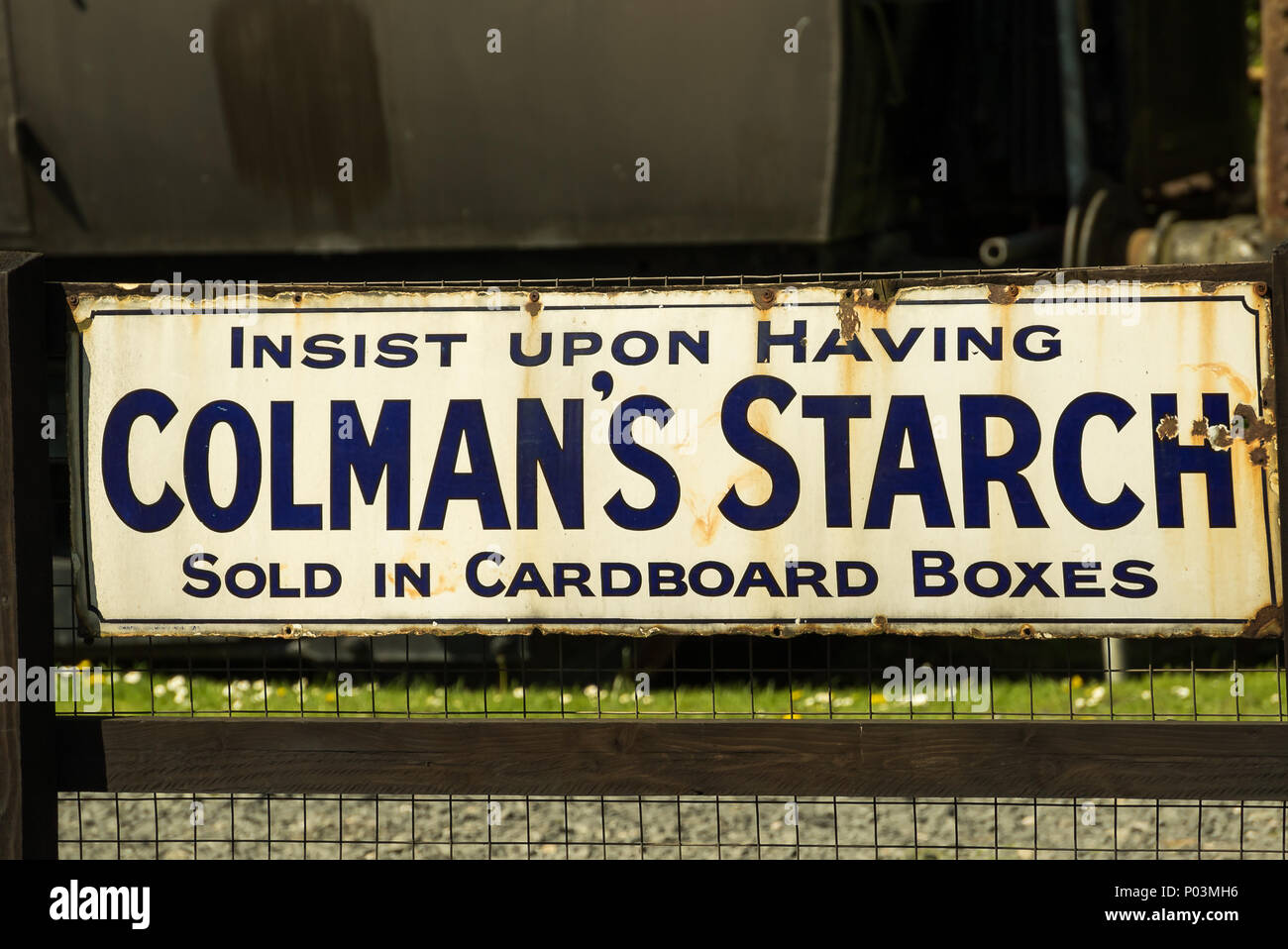 Colman's Starch original advertising sign, now preserved, on display at one of the Severn Valley Railway stations. - Stock Image