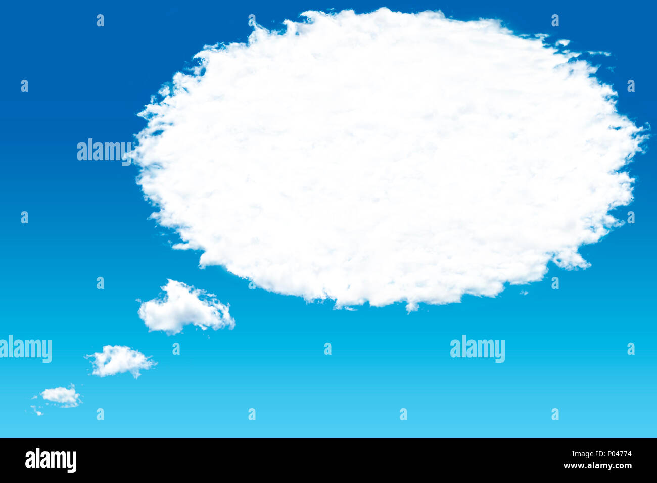 White cloud in the sky with the shape of a cartoon thinking balloon. - Stock Image