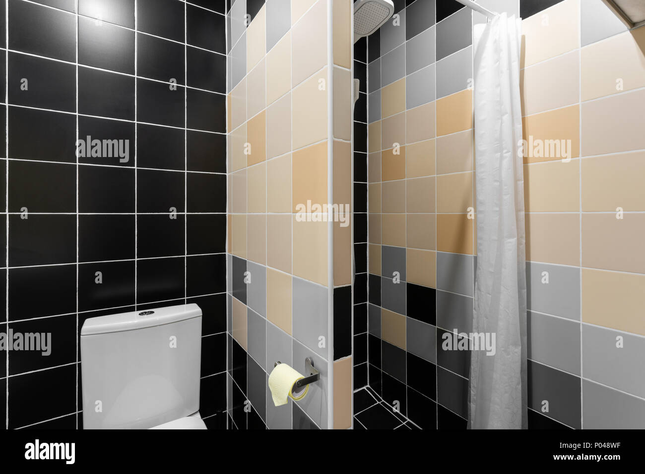 toilet lighting. Bathroom With Shower, Toilet Bowl And Sink. Hotel Standart Bedroom. Simple Stylish Interior. Interior Lighting