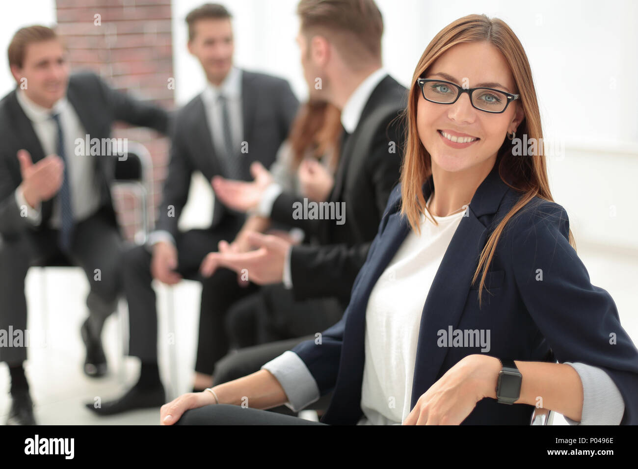 Attractive office worker standing - Stock Image