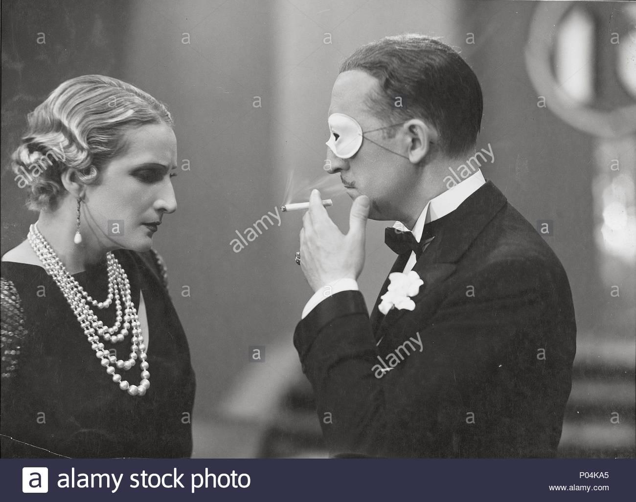 Original Film Title: DOCE HOMBRES Y UNA MUJER.  English Title: TWELVE MEN AND A WOMAN.  Film Director: FERNANDO DELGADO.  Year: 1934.  Stars: MARIANO ASQUERINO; IRENE LOPEZ HEREDIA. Credit: STAR FILMS S.A. / Album - Stock Image