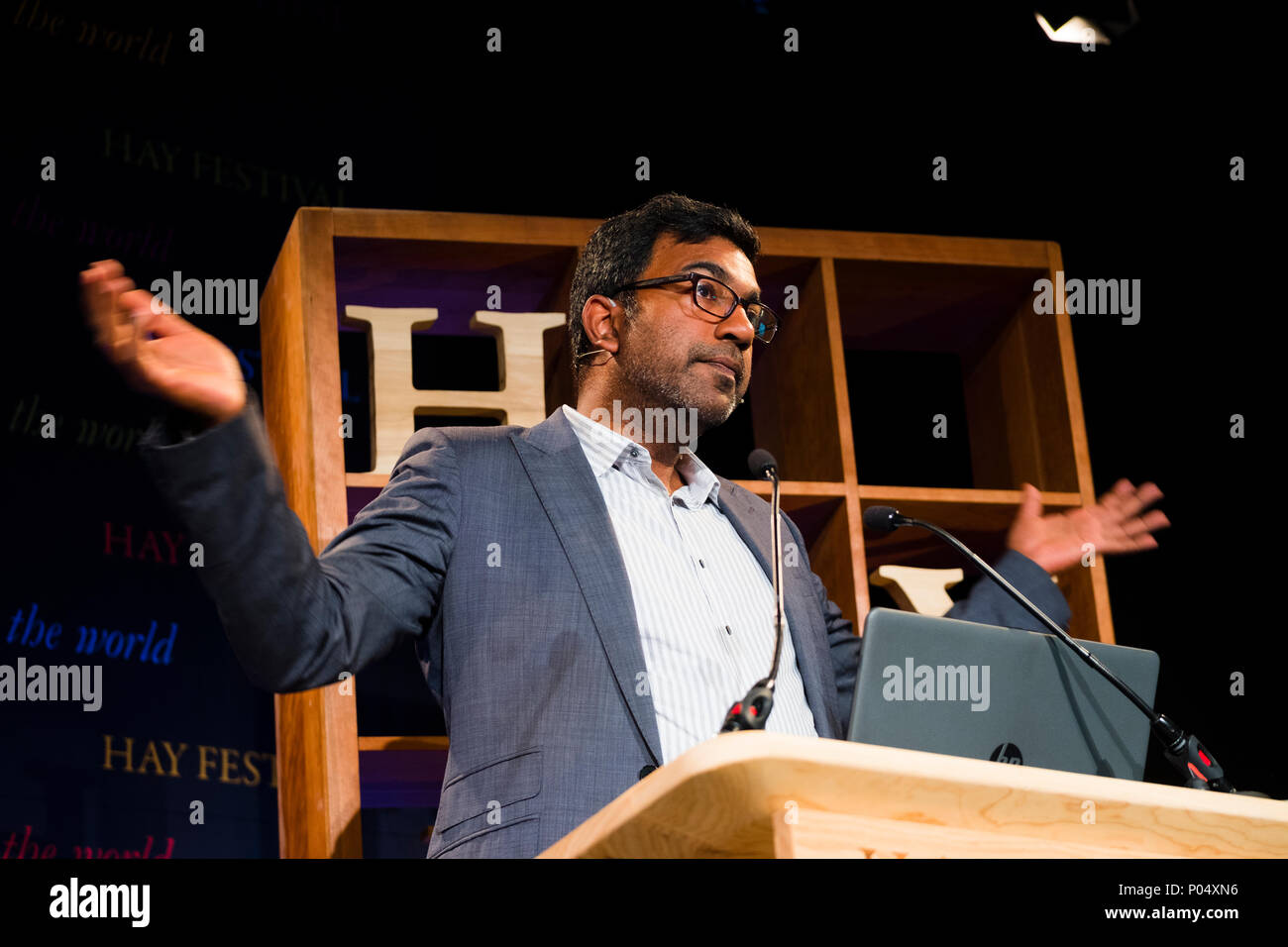 """Dr Sujit Sivasundaram , Reader in World History at Cambridge University,  fellow of Gonville and Caius College, Cambridge. He is the author of """"Nature and the Godly Empire: Science and Evangelical Mission in the Pacific, 1795-1850"""".  At the Hay Festival  of Literature and the Arts, May 2018 Stock Photo"""