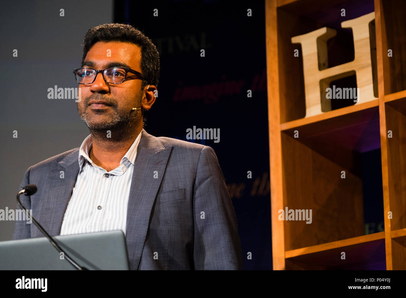 "Dr Sujit Sivasundaram , Reader in World History at Cambridge University,  fellow of Gonville and Caius College, Cambridge. He is the author of ""Nature and the Godly Empire: Science and Evangelical Mission in the Pacific, 1795-1850"".  At the Hay Festival  of Literature and the Arts, May 2018 Stock Photo"