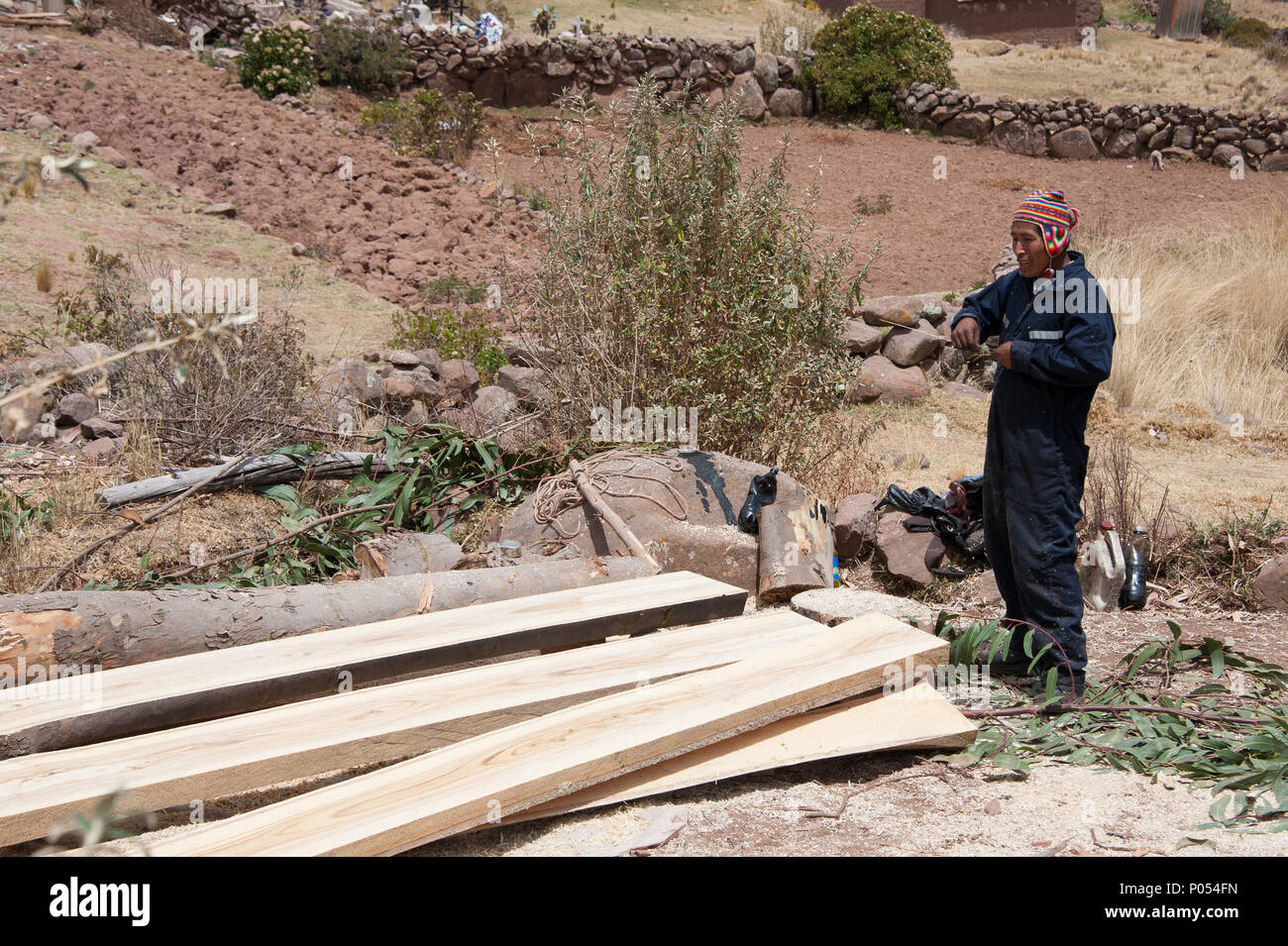 A local builder doing his work on Taquile island, Lake Titicaca. Peru - Stock Image