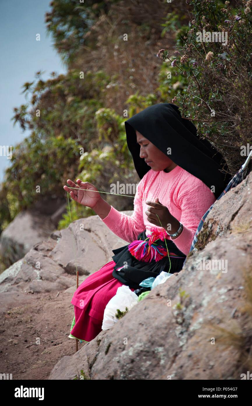 A woman knitting on Taquile island, Lake Titicaca. Peru - Stock Image