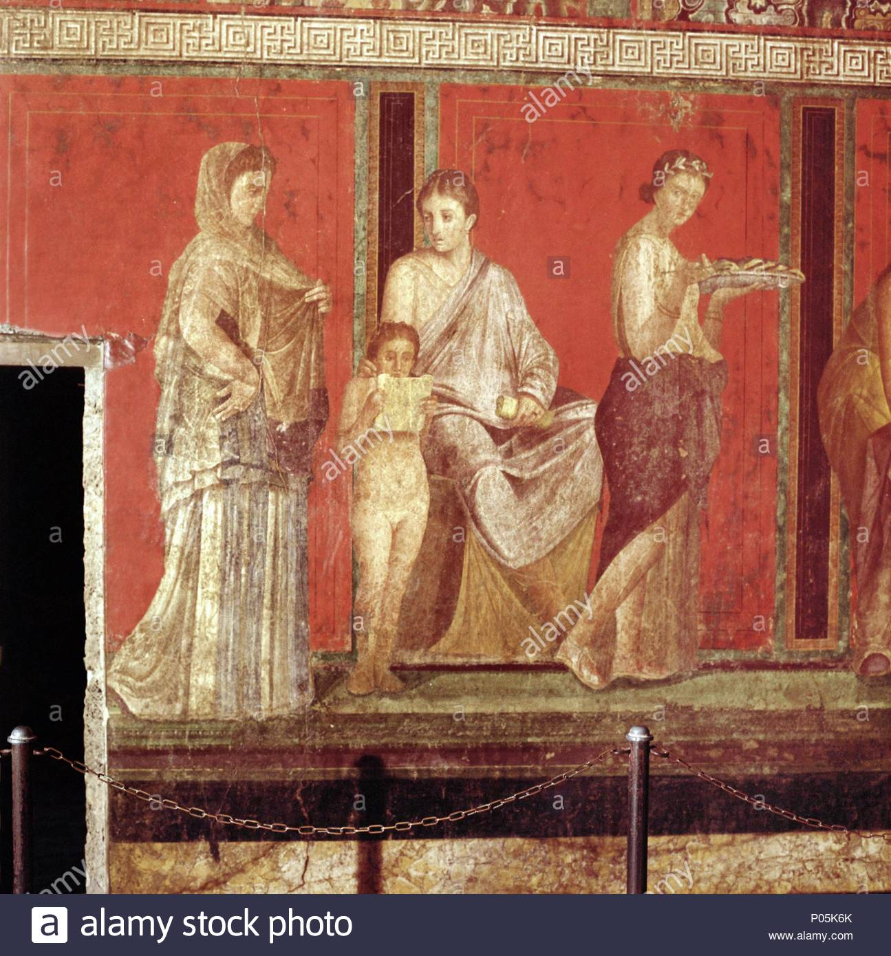 Mural from the villa of the Mysteries, Pompeii. The series of   frescoes illustrates the rites of initiation of brides to the cult of Dionysos.   Before 79 CE. Location: Archaeological Site, Pompeii, Italy. - Stock Image