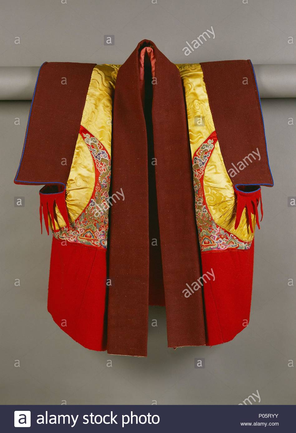 A monkïs waistcoat (Toegag) -the attire of a monk consists of a waistcoat with stitched inserts, a wrap-around and an overgarment and cloak. Location: National Museum, Paro, Bhutan. - Stock Image