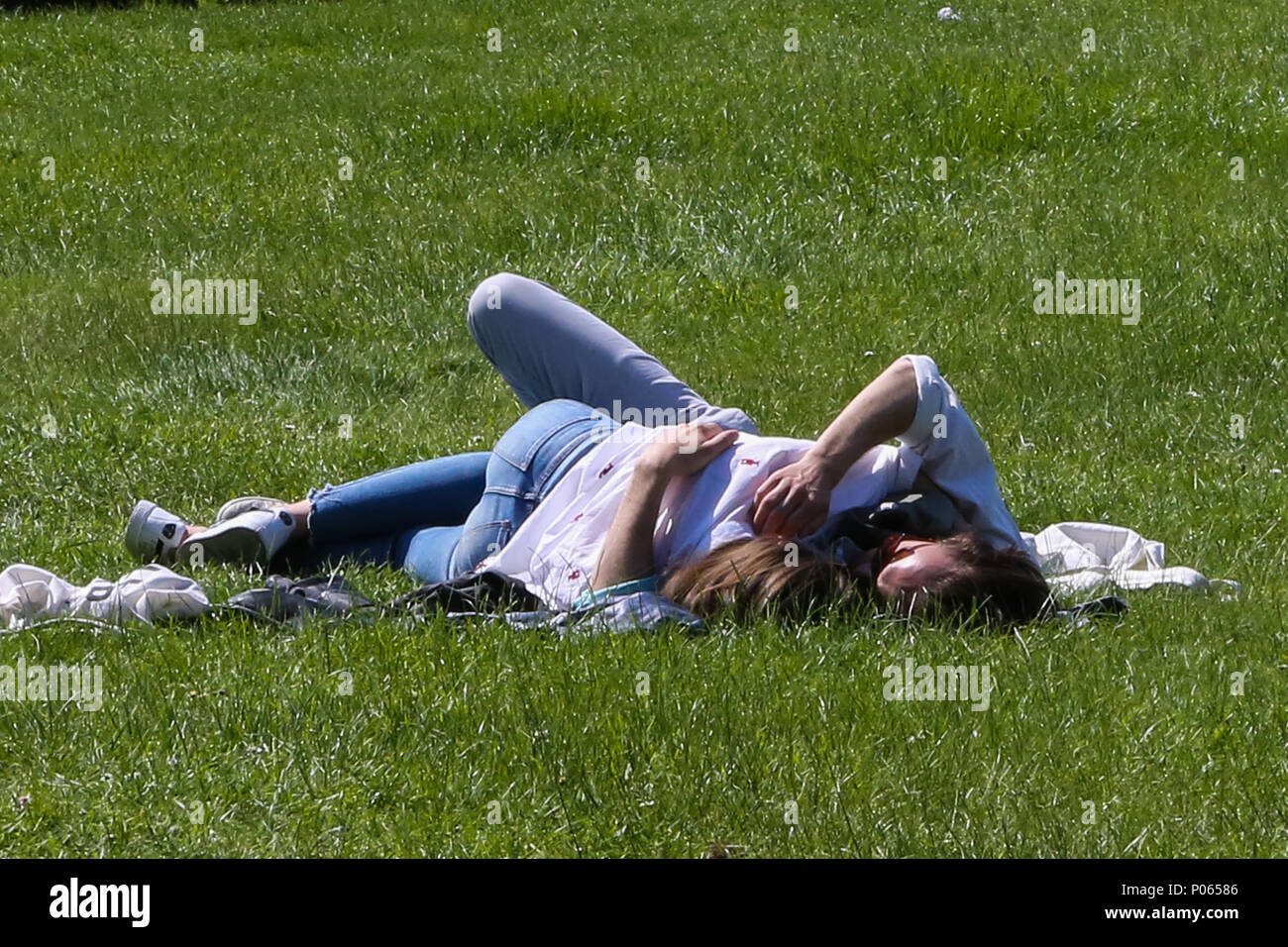 Sunbather makes the most of the hot weather in Alexandra Palace, north London during the mini heatwave.  Featuring: Atmosphere, View Where: London, United Kingdom When: 08 May 2018 Credit: Dinendra Haria/WENN - Stock Image