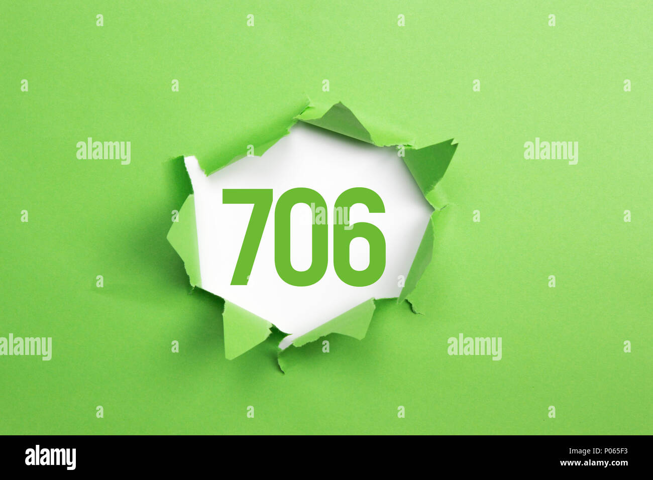Green Number 706 on green paper background - Stock Image