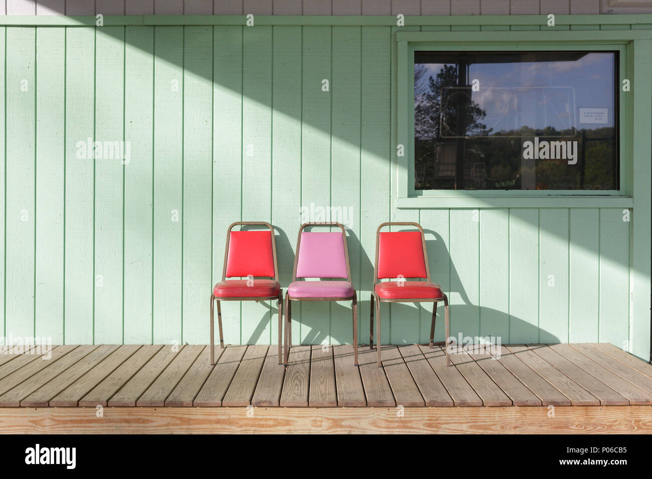 AMSTERDAM, NY/USA - MAY 6 2017: Three chairs on a porch near Amsterdam, New York State, USA. - Stock Image