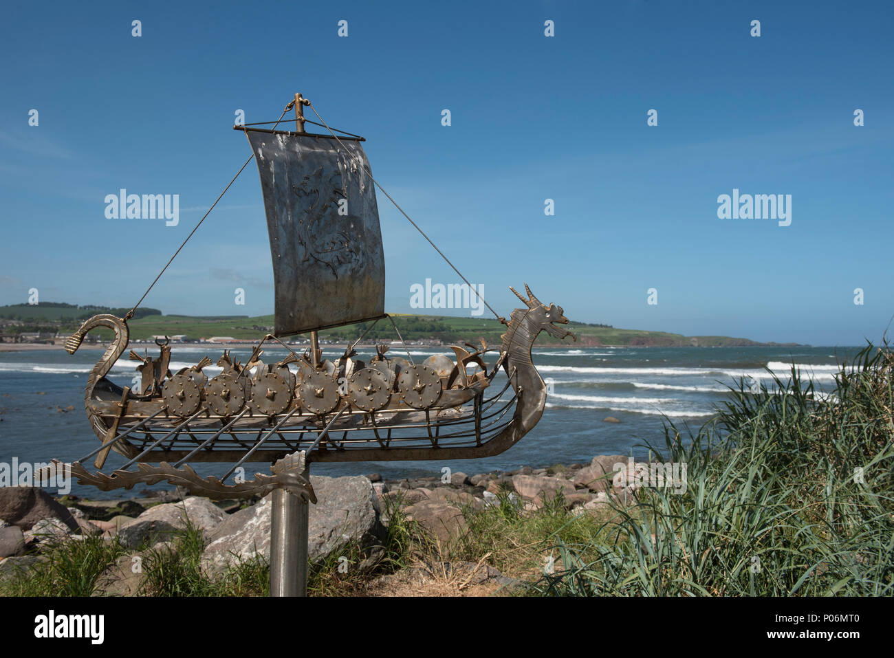 Stonehaven bay boardwalk has several interesting sculptures, the Viking longboat sculpture, Stonehaven, Aberdeenshire, Scotland. - Stock Image