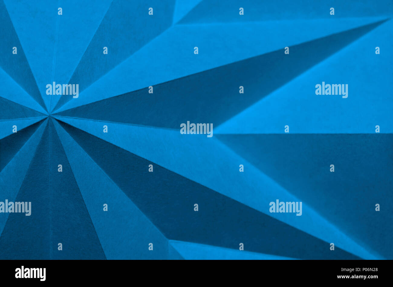 blue origami background abstract wallpaper. Shallow focus, graphic macro, angular, monochrome folded paper. Pantone 16-4132; Little Boy Blue - Stock Image