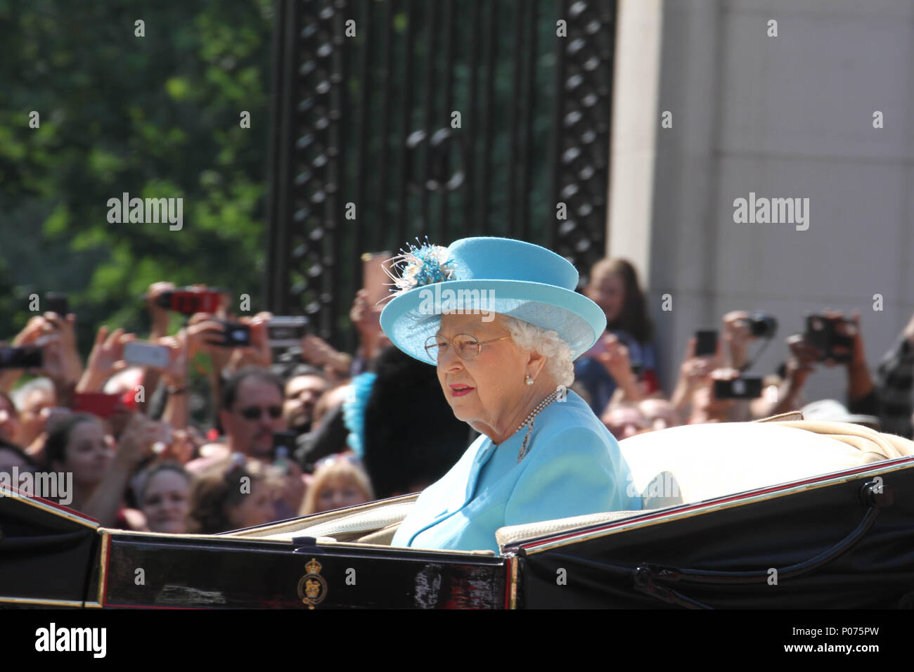 London, UK 9 June 2018: HMR Queen Elizabeth seen on horse-drawn carriage as they make their way to the Horse Guards Parade Ground on 9 June 2018. Over 1400 parading soldiers, 200 horses and 400 musicians come together each June in a great display of military precision, horsemanship and fanfare to mark The Queen's official birthday. Credit: David Mbiyu/Alamy - Stock Image