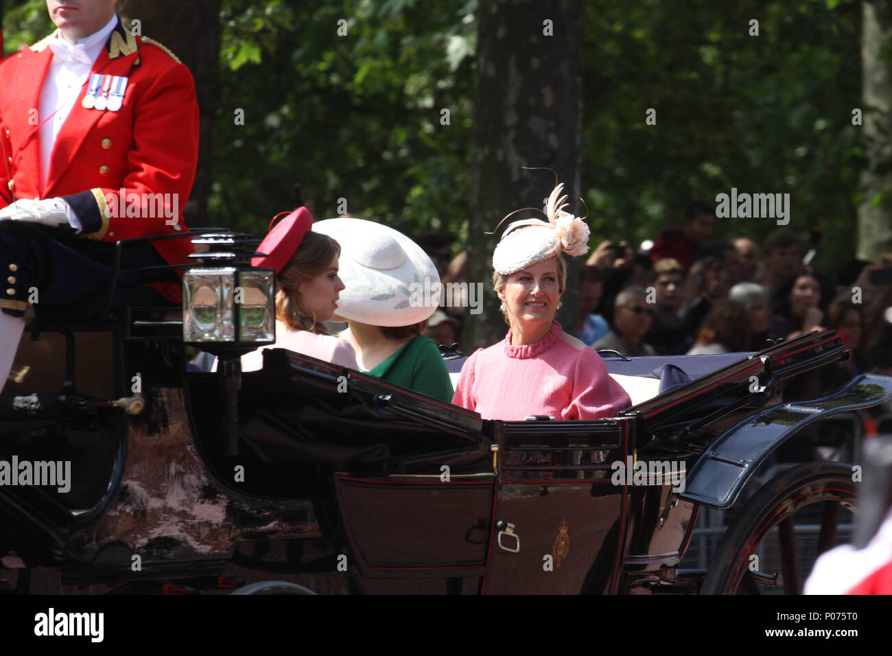 London, UK 9 June 2018: Members of the Royal Family seen on a horse drawn carriage as they make their way to the Horse Guards Parade Ground on 9 June 2018. Over 1400 parading soldiers, 200 horses and 400 musicians come together each June in a great display of military precision, horsemanship and fanfare to mark The Queen's official birthday. Credit: David Mbiyu/Alamy - Stock Image