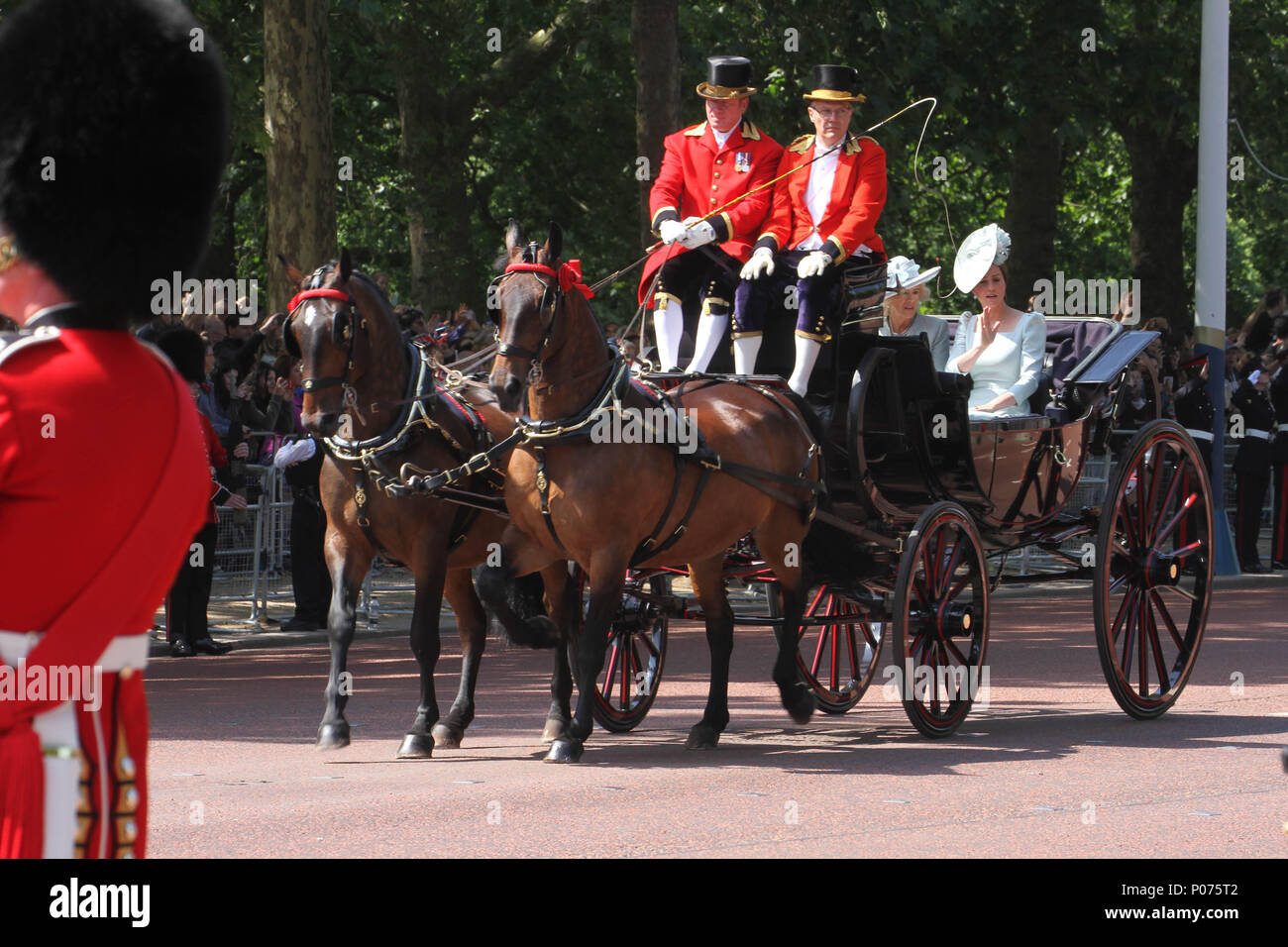 London, UK 9 June 2018: Camila the Duchess of Cornwall with Catherine, Duchess of Cambridge seen on a horse-drawn carriage as they make their way to the Horse Guards Parade Ground on 9 June 2018. Over 1400 parading soldiers, 200 horses and 400 musicians come together each June in a great display of military precision, horsemanship and fanfare to mark The Queen's official birthday. Credit: David Mbiyu/Alamy - Stock Image