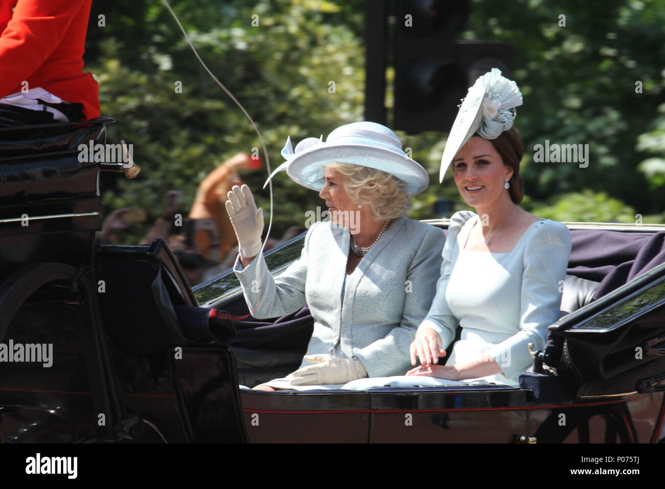London, UK 9 June 2018: Camila the Duchess of Cornwall with Catherine, Duchess of Cambridge seen on a horse drawn carriage as they make their way to the Horse Guards Parade Ground on 9 June 2018. Over 1400 parading soldiers, 200 horses and 400 musicians come together each June in a great display of military precision, horsemanship and fanfare to mark The Queen's official birthday. Credit: David Mbiyu/Alamy - Stock Image